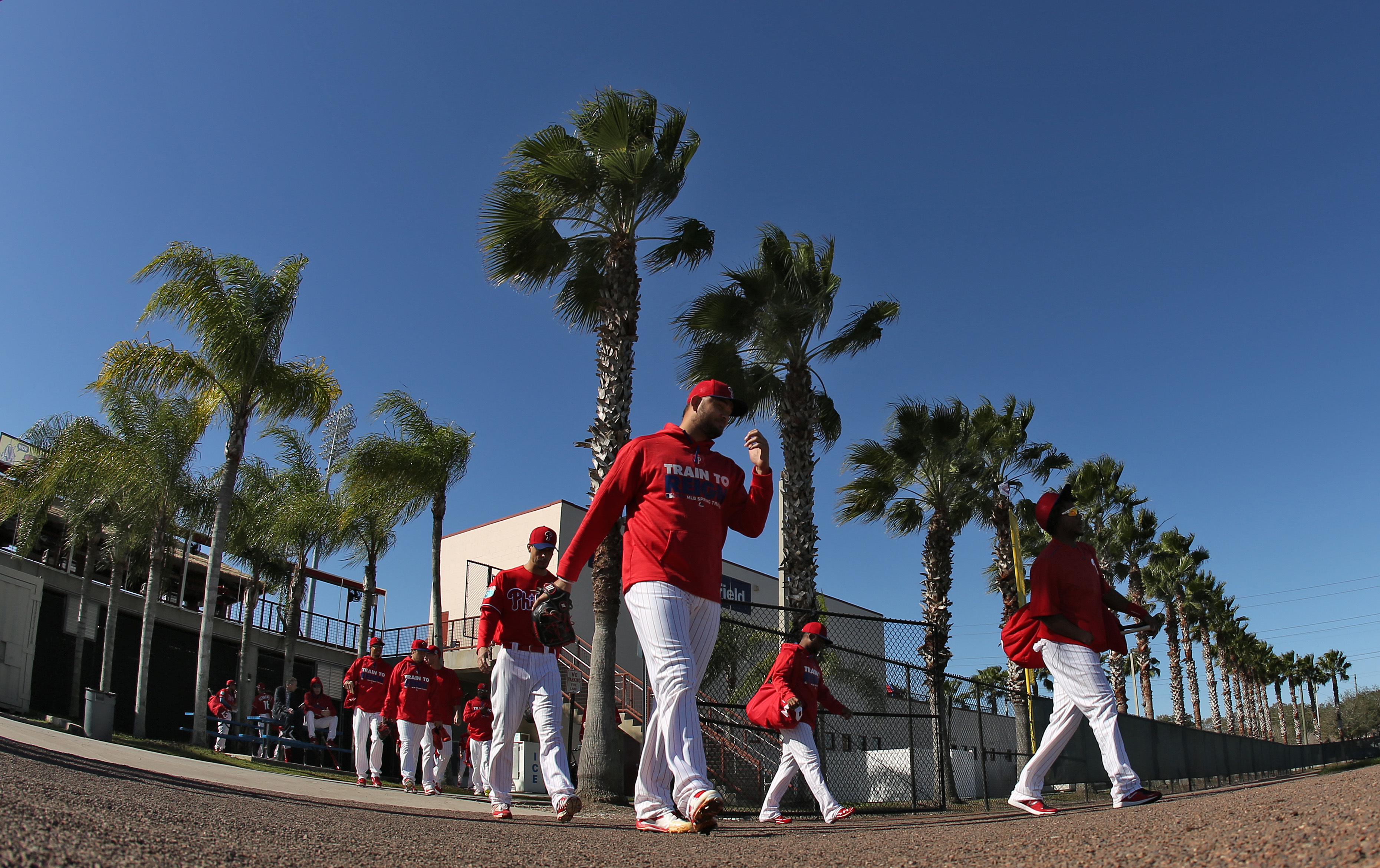 Philadelphia Phillies players head to the field for a  spring training baseball workout, Friday, Feb. 26, 2016, in Clearwater, Fla. (AP Photo/Chris O'Meara)