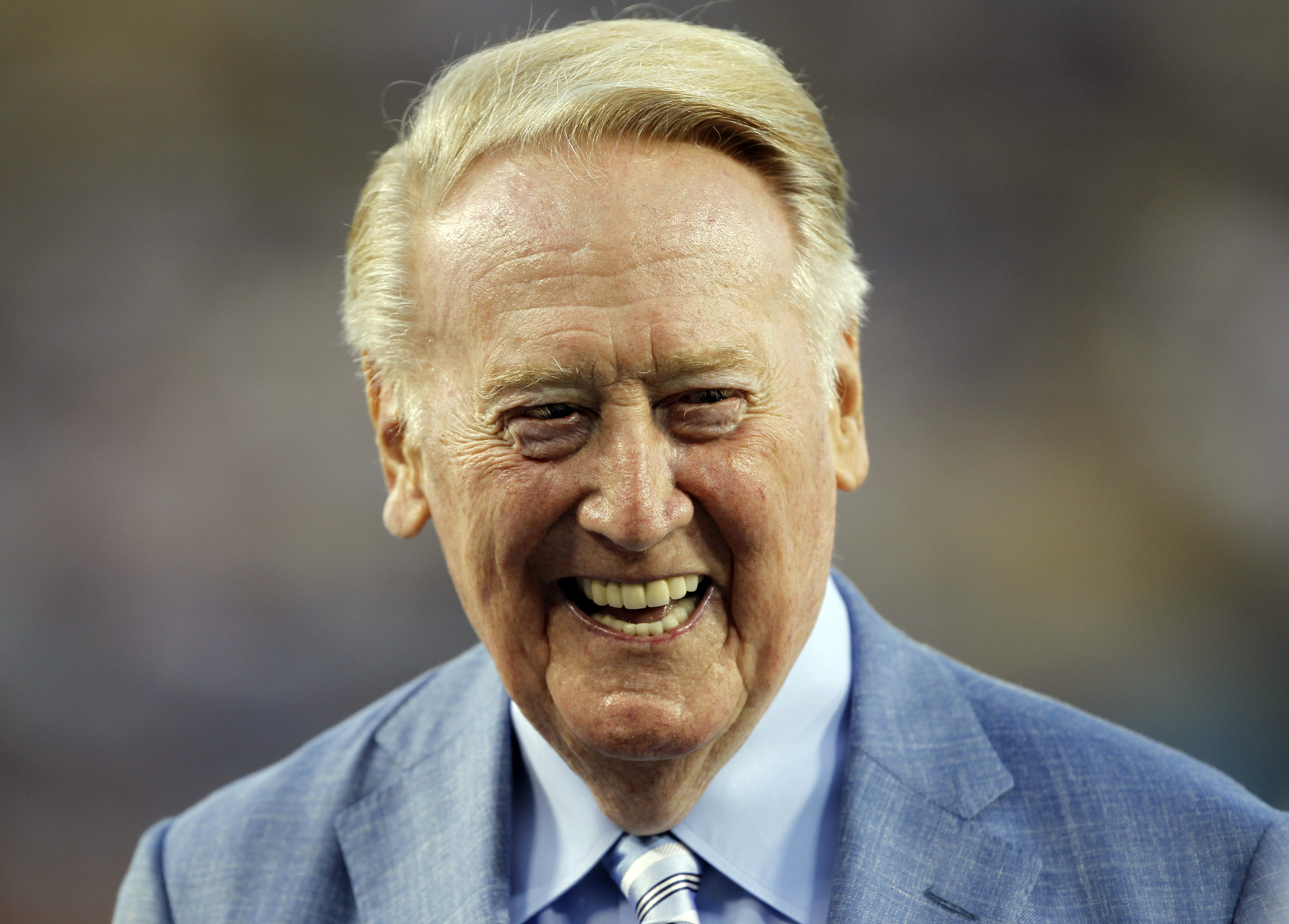 Los Angeles Dodgers broadcaster Vin Scully is honored before a baseball game against the Arizona Diamondbacks in Los Angeles, Wednesday, Sept. 23, 2015. Scully was given a Guinness World Records certificate for the longest career as a sports broadcaster f