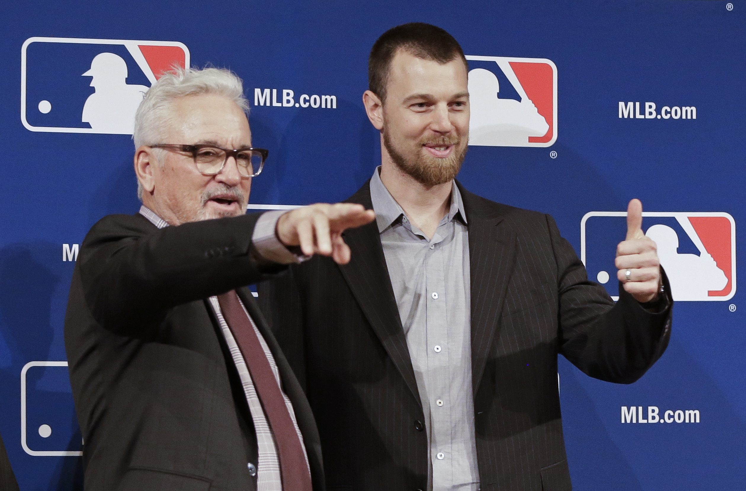 FILE - In this Dec. 9, 2015, file photo, Chicago Cubs manager Joe Maddon, left, joins switch-hitting free agent Ben Zobrist for the announcement that Zobrist had signed with the Cubs, at bseball's winter meetings in Nashville, Tenn. Zobrist, 34, brings ma