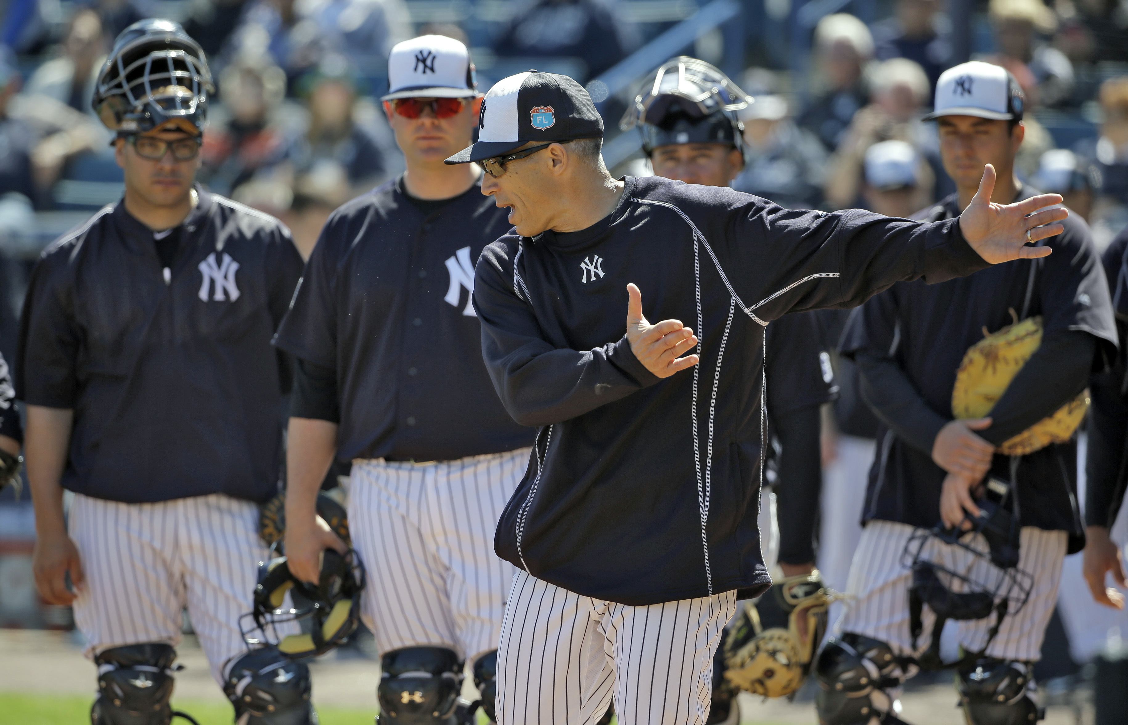 New York Yankees manager Joe Girardi works on fundamentals with catchers during a spring training baseball workout Saturday, Feb. 27, 2016, in Tampa, Fla. (AP Photo/Chris O'Meara)