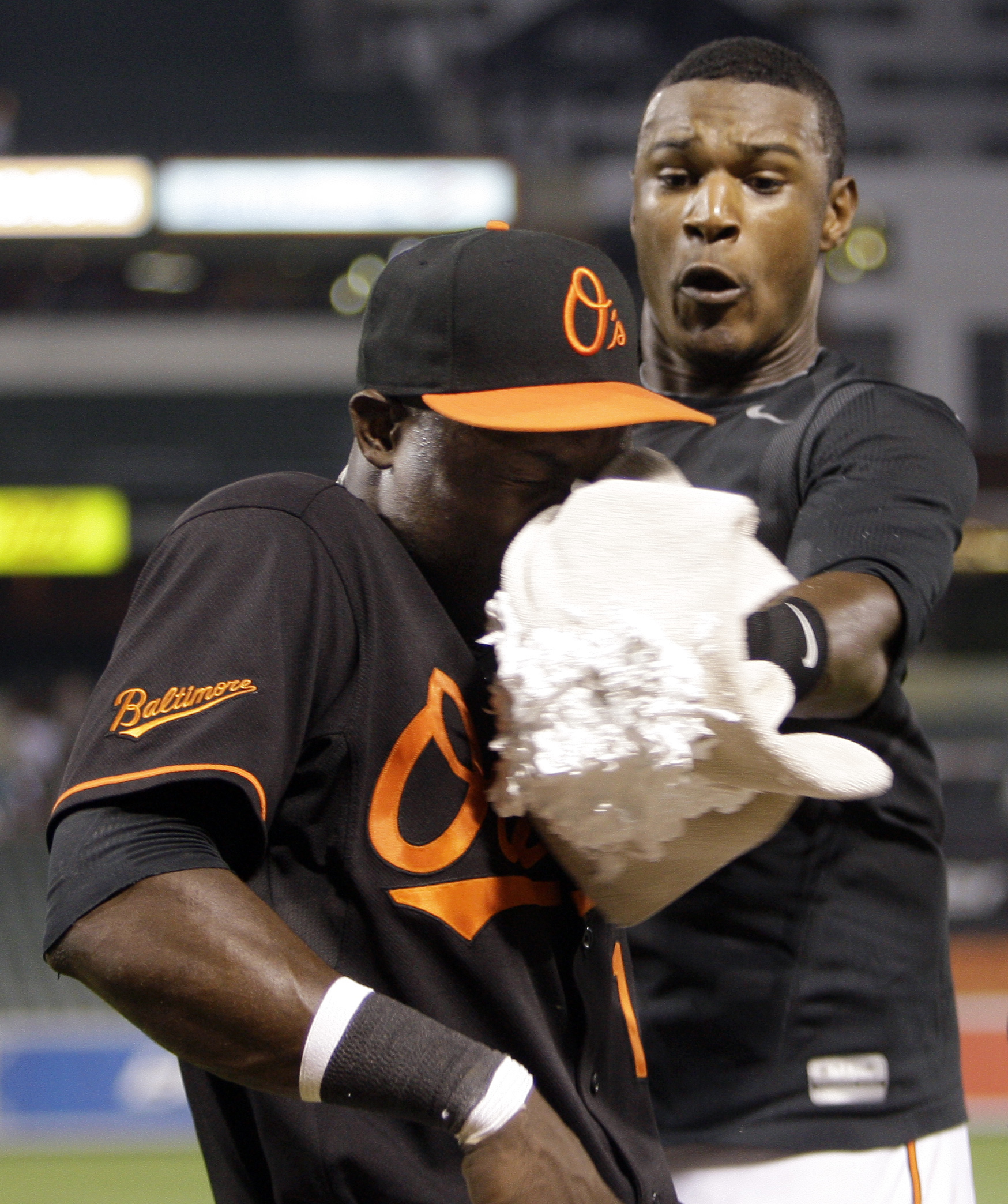 FILE - In this Aug. 14, 2009, file photo, Baltimore Orioles' Felix Pie, left, is hit in the face with a shaving cream pie by teammate Adam Jones, right, after their team defeated the Los Angeles Angels inn a baseball game in Baltimore. Over the last sever