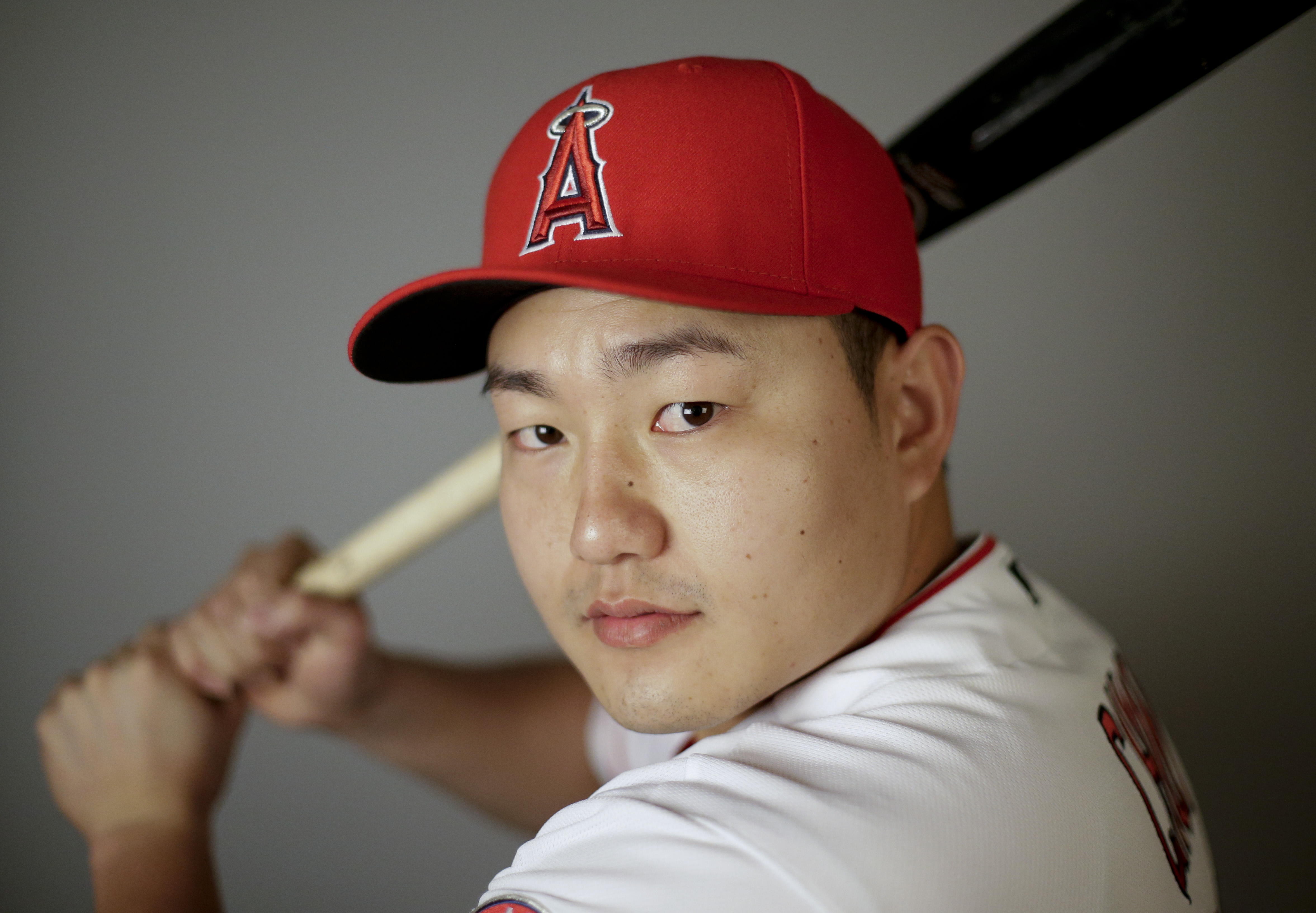 FILE - In this Feb. 26, 2016, file photo,  Ji-Man Choi of the Los Angeles Angels baseball team, poses in Tempe, Ariz. Ji-Man Choi didn't become a swtich-hitter until midway through last season. His remarkable mid-career adjustment could make him part of t