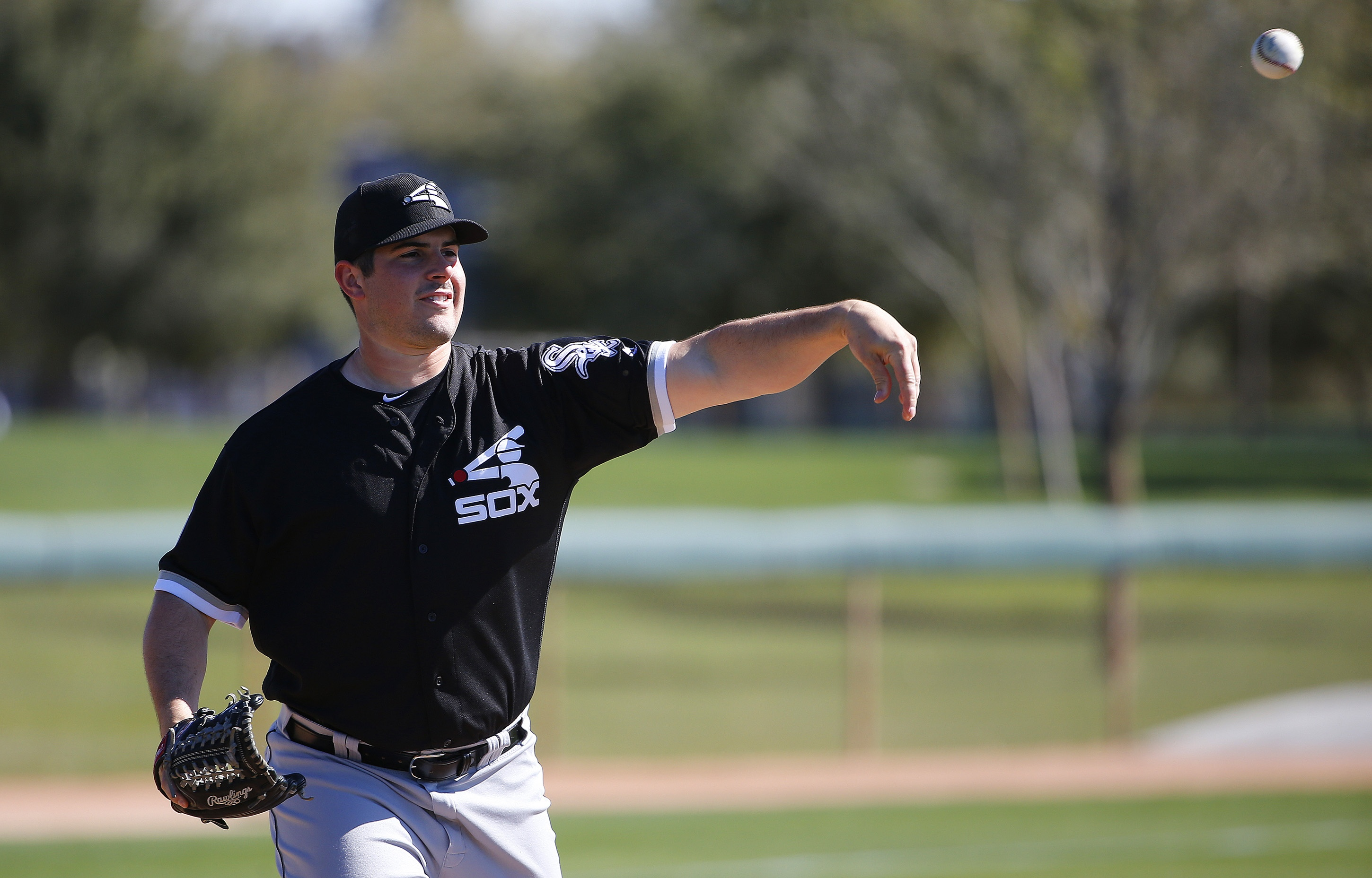 FILE - In this Feb. 24, 2016, file photo, Chicago White Sox's Carlos Rodon throws to first base during a spring training baseball workout, in Glendale, Ariz. One of four lefties in the White Sox rotation, Rodon looks to refine things and improve on a 9-6,