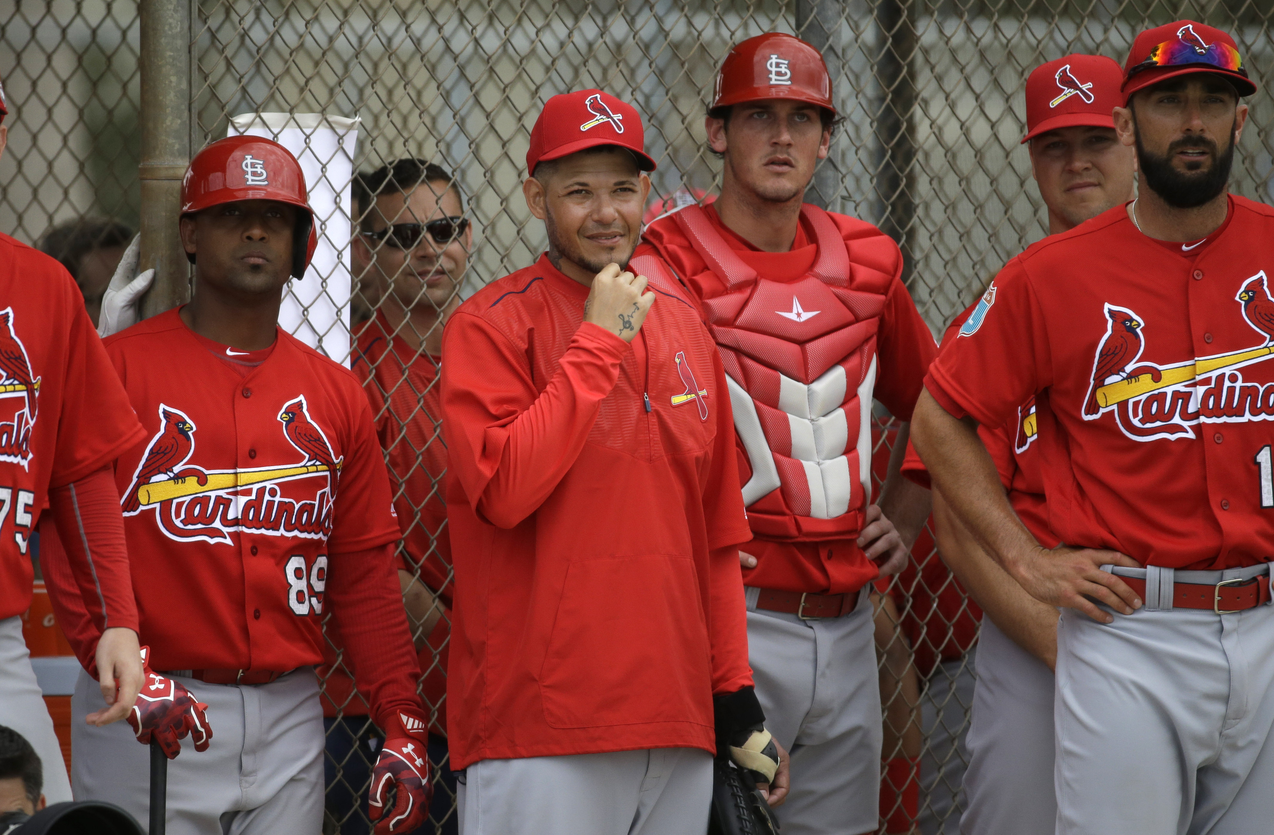 St. Louis Cardinals catcher Yadier Molina, center, watches from the dugout during a spring training intrasquad baseball game Monday, Feb. 29, 2016, in Jupiter, Fla. (AP Photo/Jeff Roberson)