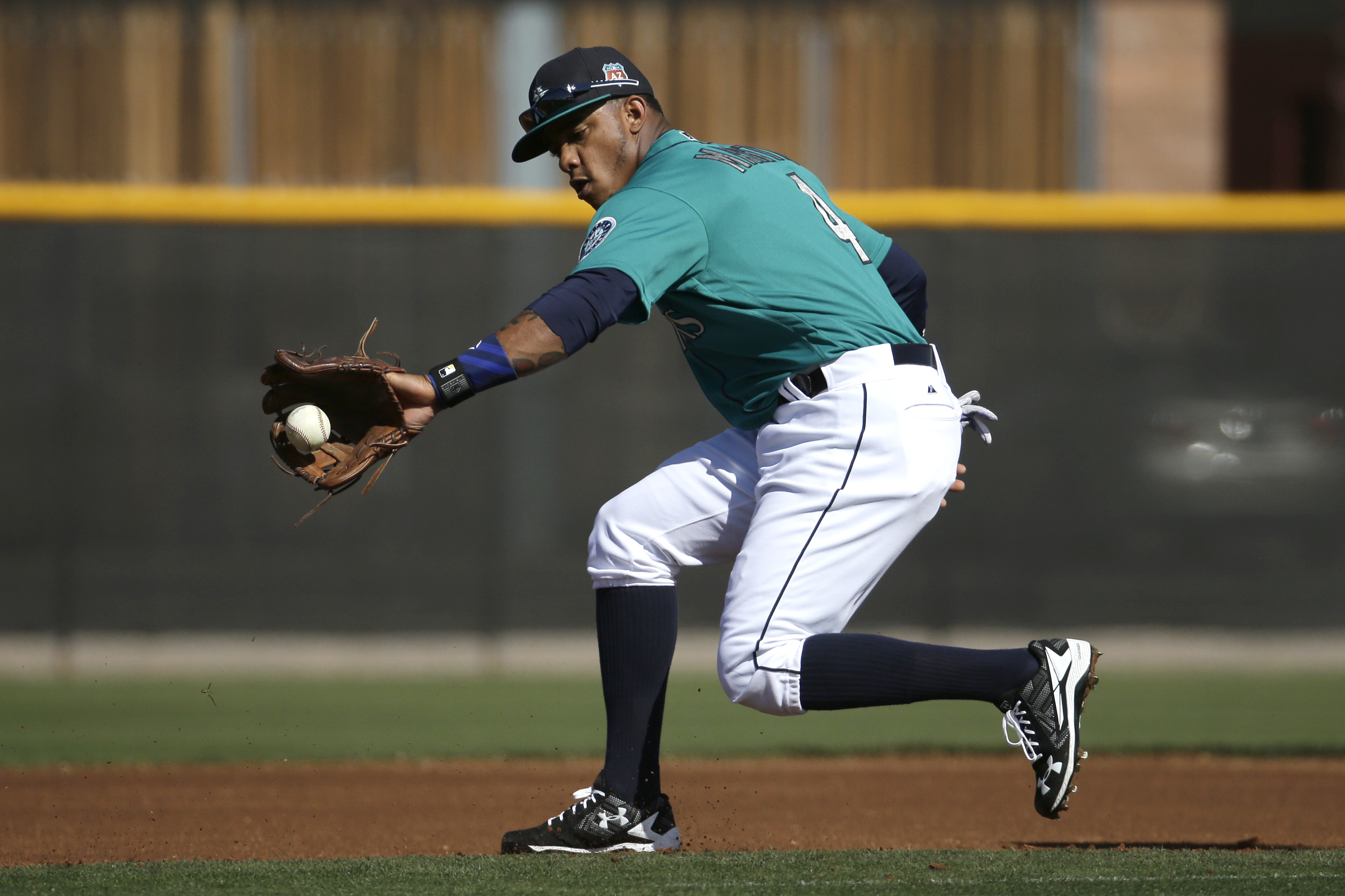 FILE - In this Feb. 26, 2016, file photo, Seattle Mariners' Ketel Marte fields a ball during spring training baseball practice, in Peoria, Ariz. Marte showed enough last season that even the new Seattle Mariners coaching staff believed he could be their s