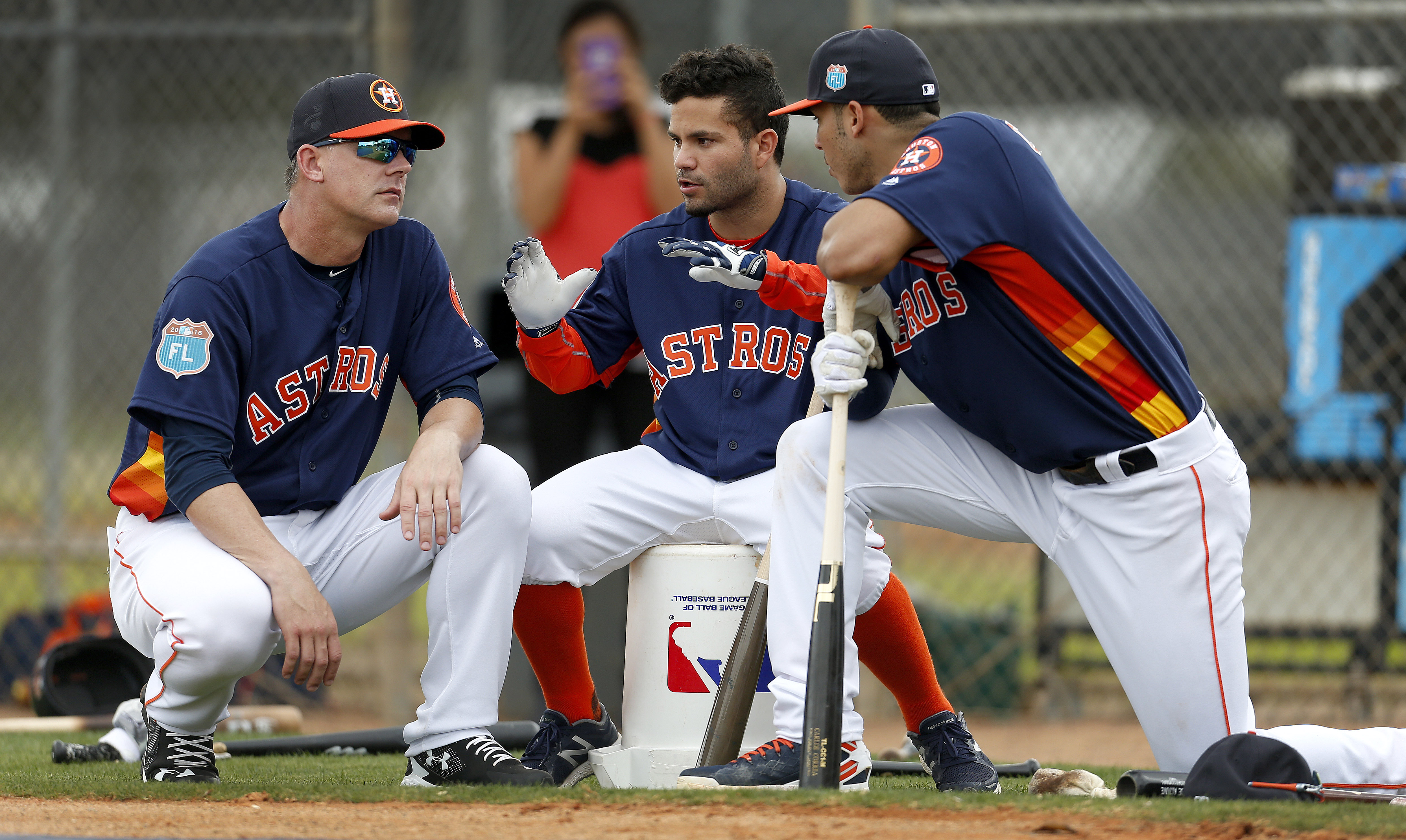 FILE - In this Feb. 23, 2016, file photo, Houston Astros manager A.J. Hinch, left, and Astros' Jose Altuve and Carlos Correa chat during a workout at the Astros spring training camp in Kissimmee, Fla. Altuve is one of only a handful of remaining Astros wh
