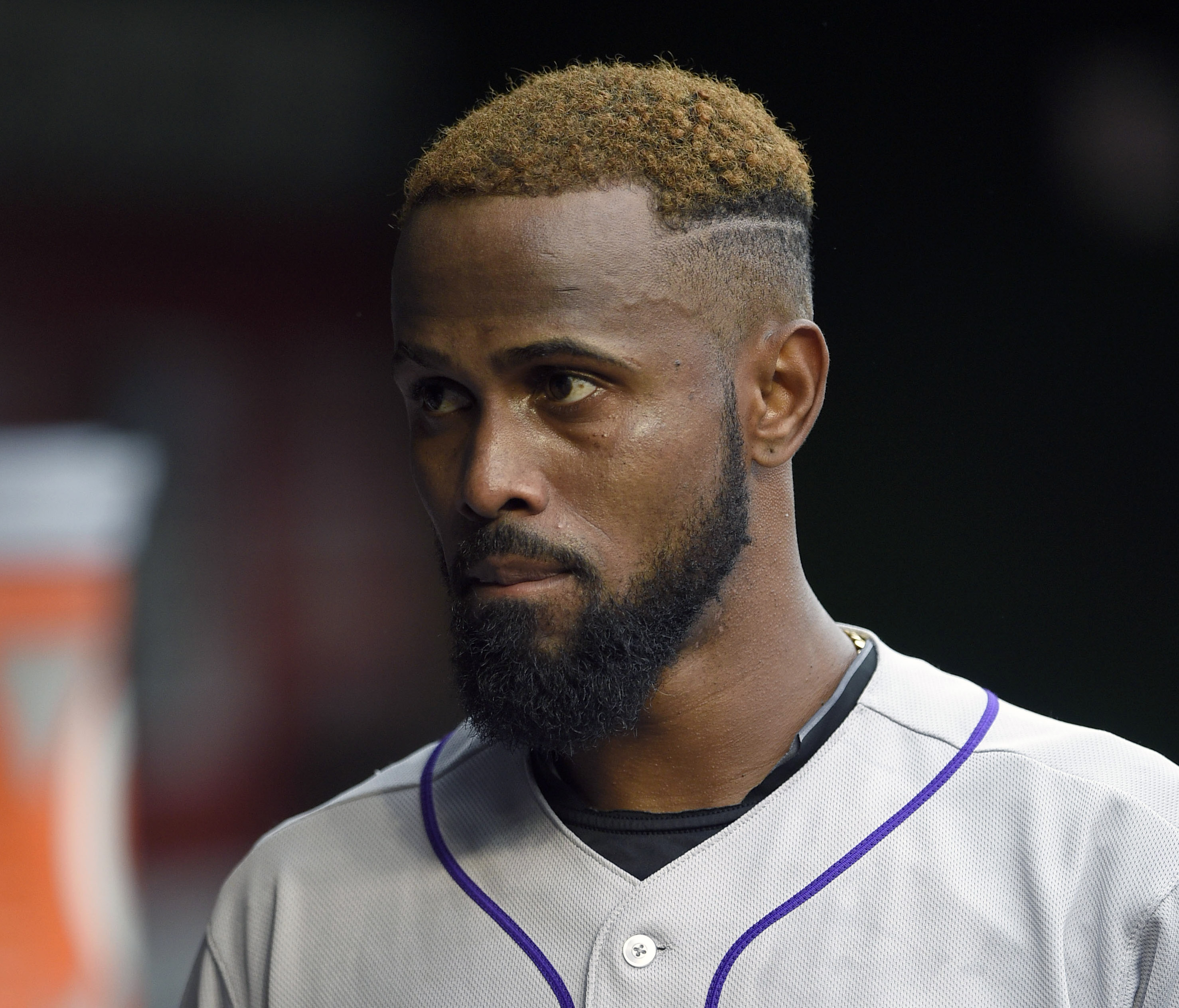 FILE - In this Aug. 7, 2015, file photo, Colorado Rockies shortstop Jose Reyes (7) looks on before a baseball game against the Washington Nationals, in Washington. The Rockies began their exhibition schedule Wednesday, March 2, 2016, facing the possibilit