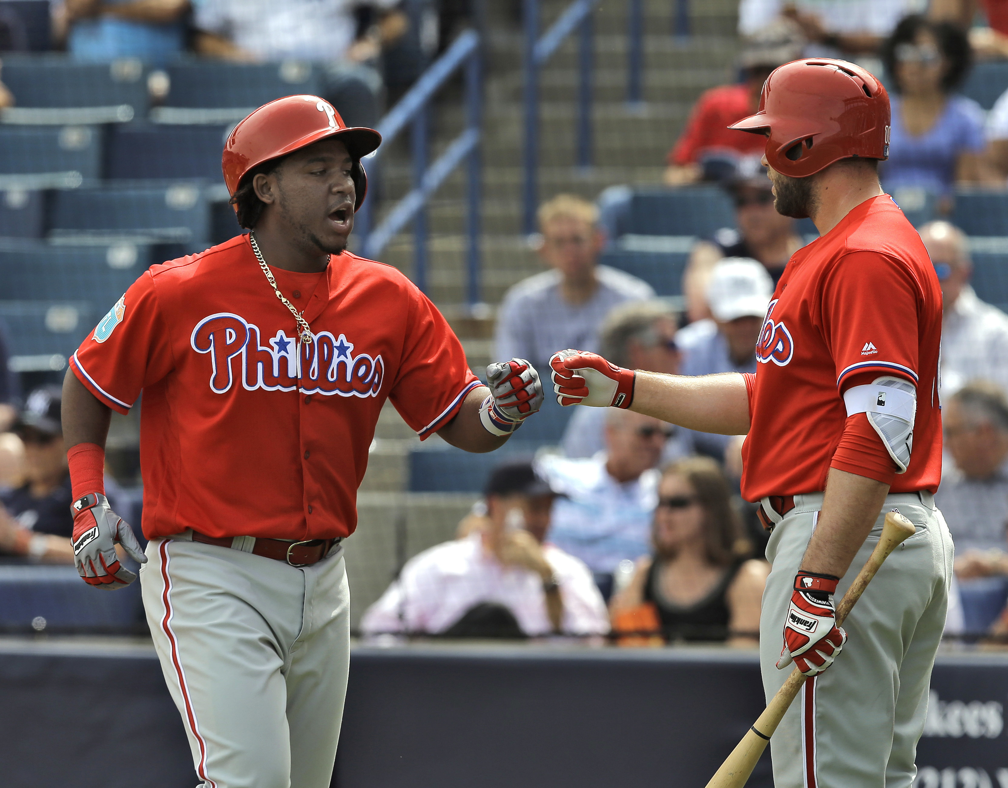 Philadelphia Phillies' Maikel Franco, left, high fives on-deck batter Darin Ruf after hitting a home run off New York Yankees relief pitcher Diego Moreno during the fourth inning of a spring training baseball game Thursday, March 3, 2016, in Tampa, Fla. (