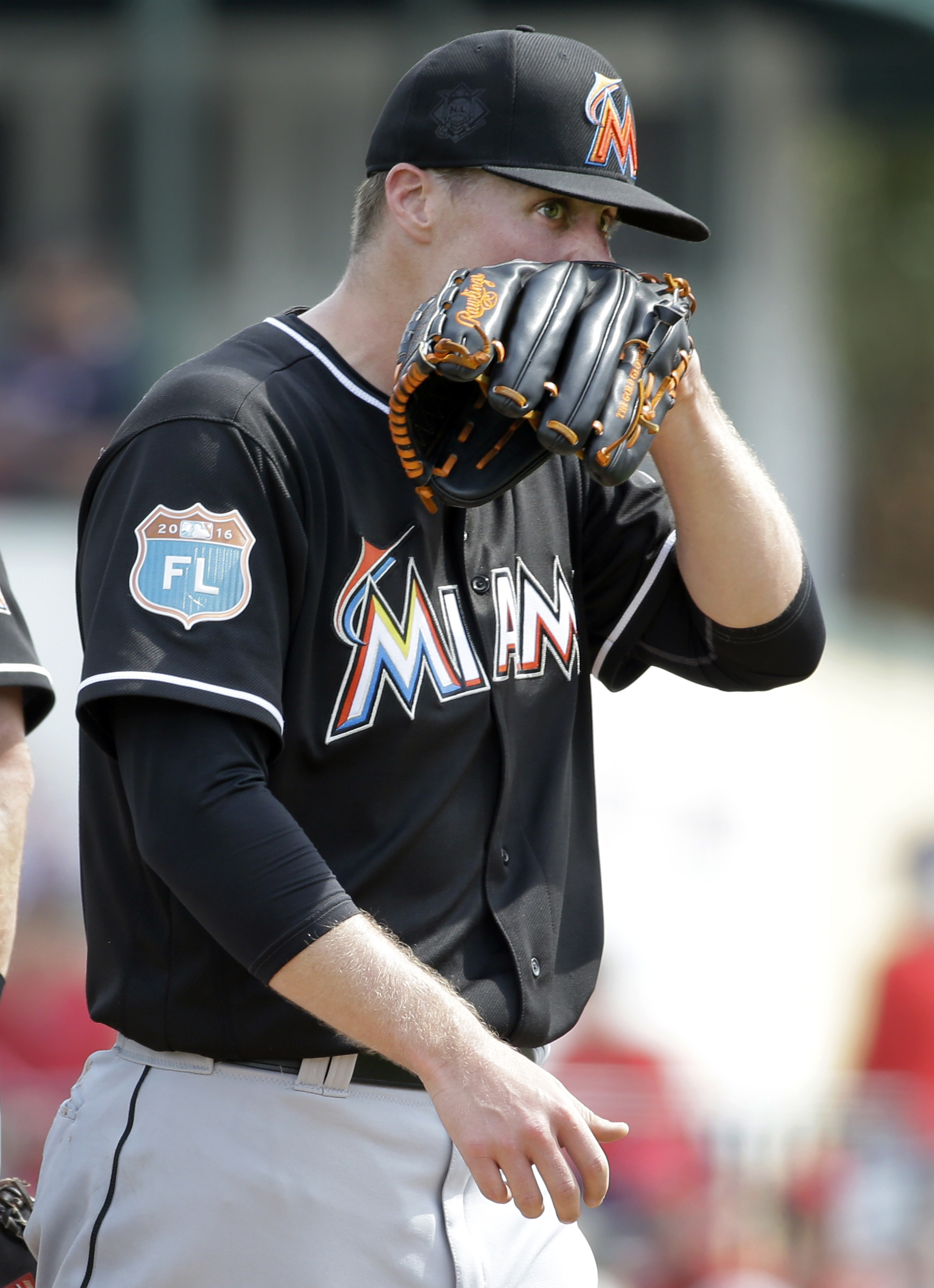 Miami Marlins starting pitcher Tom Koehler heads off the field after being removed from an exhibition spring training baseball game against the St. Louis Cardinals during the second inning Thursday, March 3, 2016, in Jupiter, Fla. (AP Photo/Jeff Roberson)