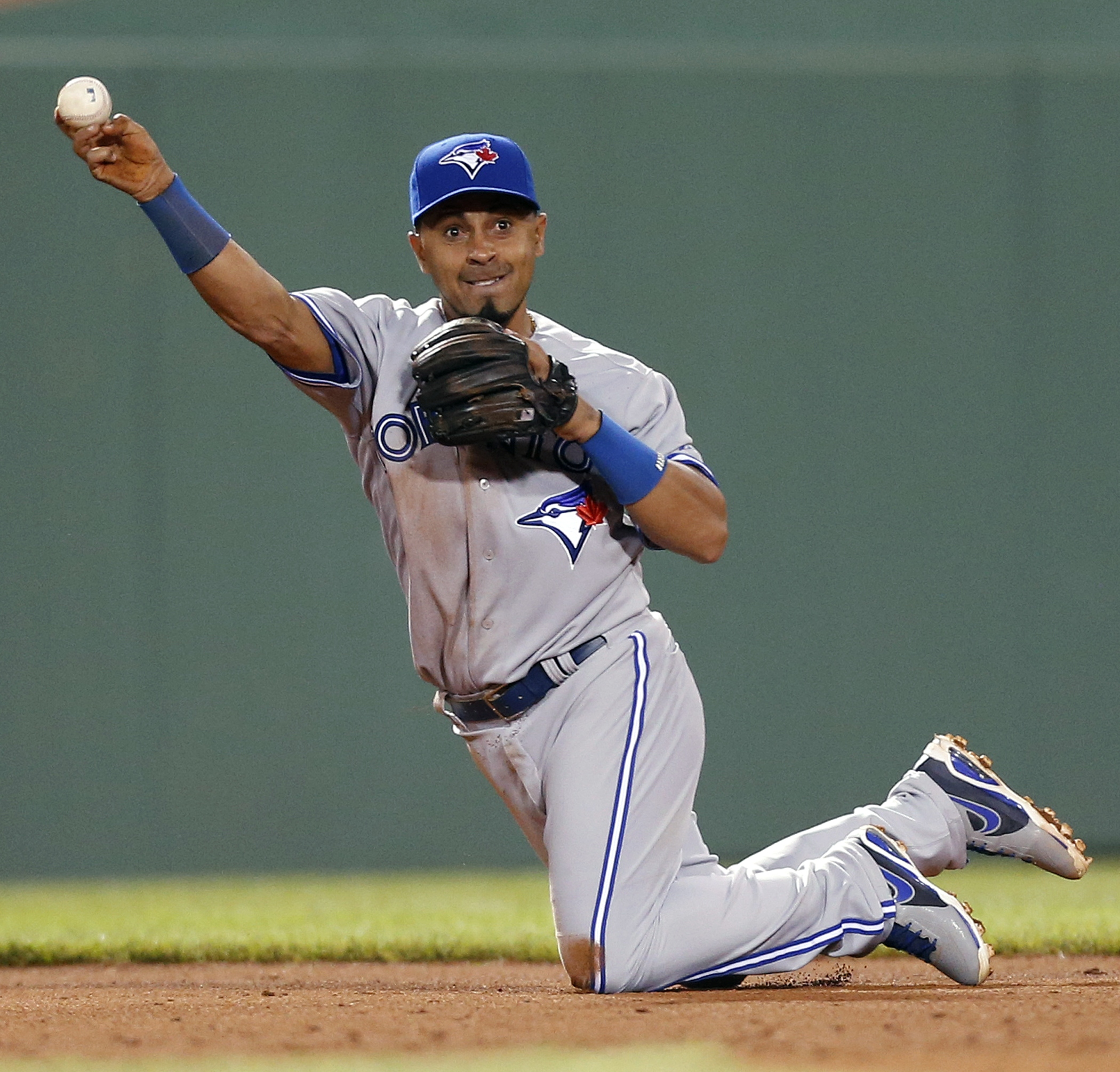 FILE - In this May 10, 2013, file photo, Toronto Blue Jays' Maicer Izturis throws to second base after fielding a single by Boston Red Sox's Dustin Pedroia in the fifth inning of a baseball game in Boston. The 35-year-old infielder, in spring training cam