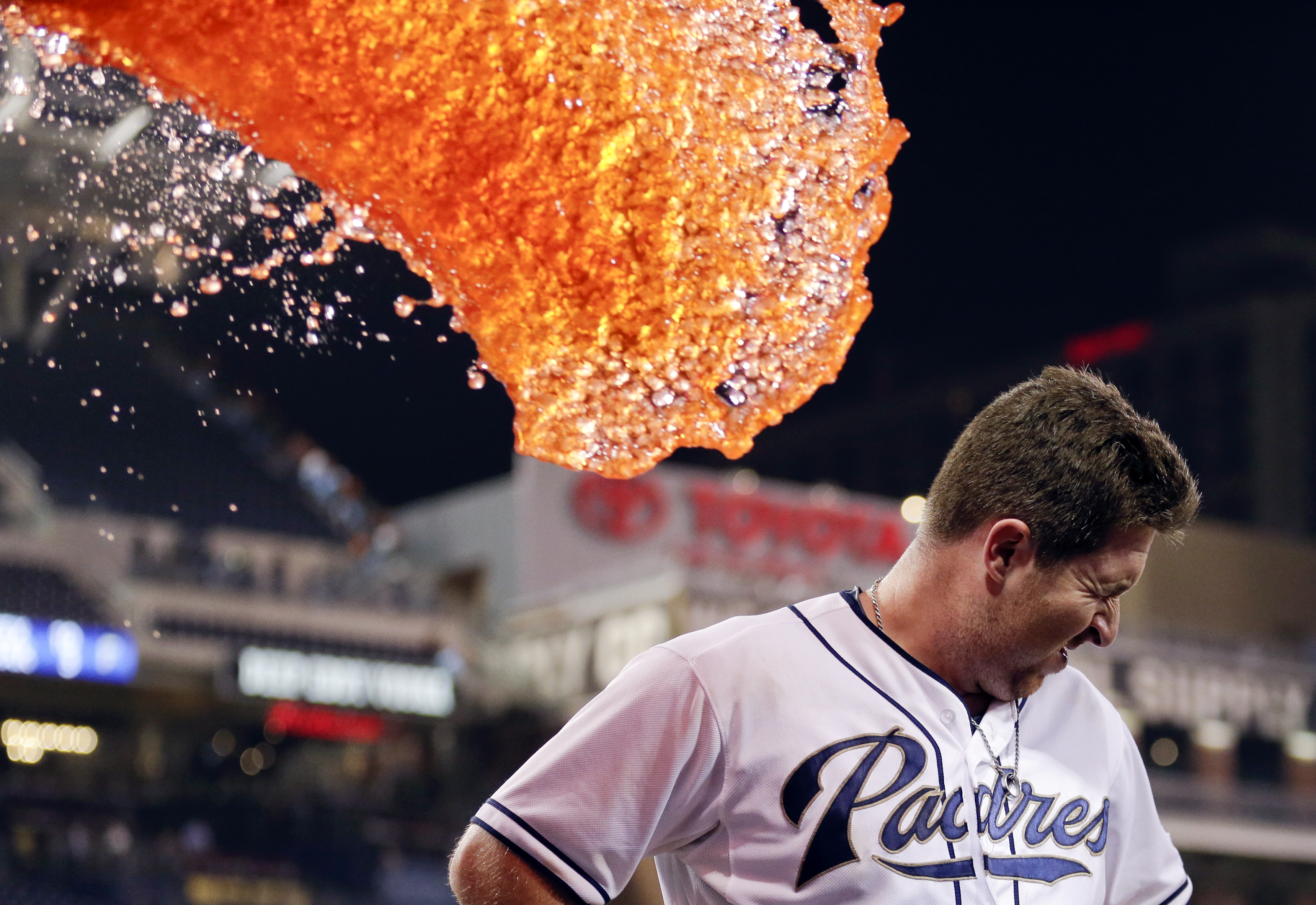 FILE - In this Sept. 23, 2015, file photo, San Diego Padres second baseman Jedd Gyorko braces himself as he is doused in liquid after hitting a walk-off single to defeat the San Francisco Giants in a baseball game in San Diego. The photo was honored by th