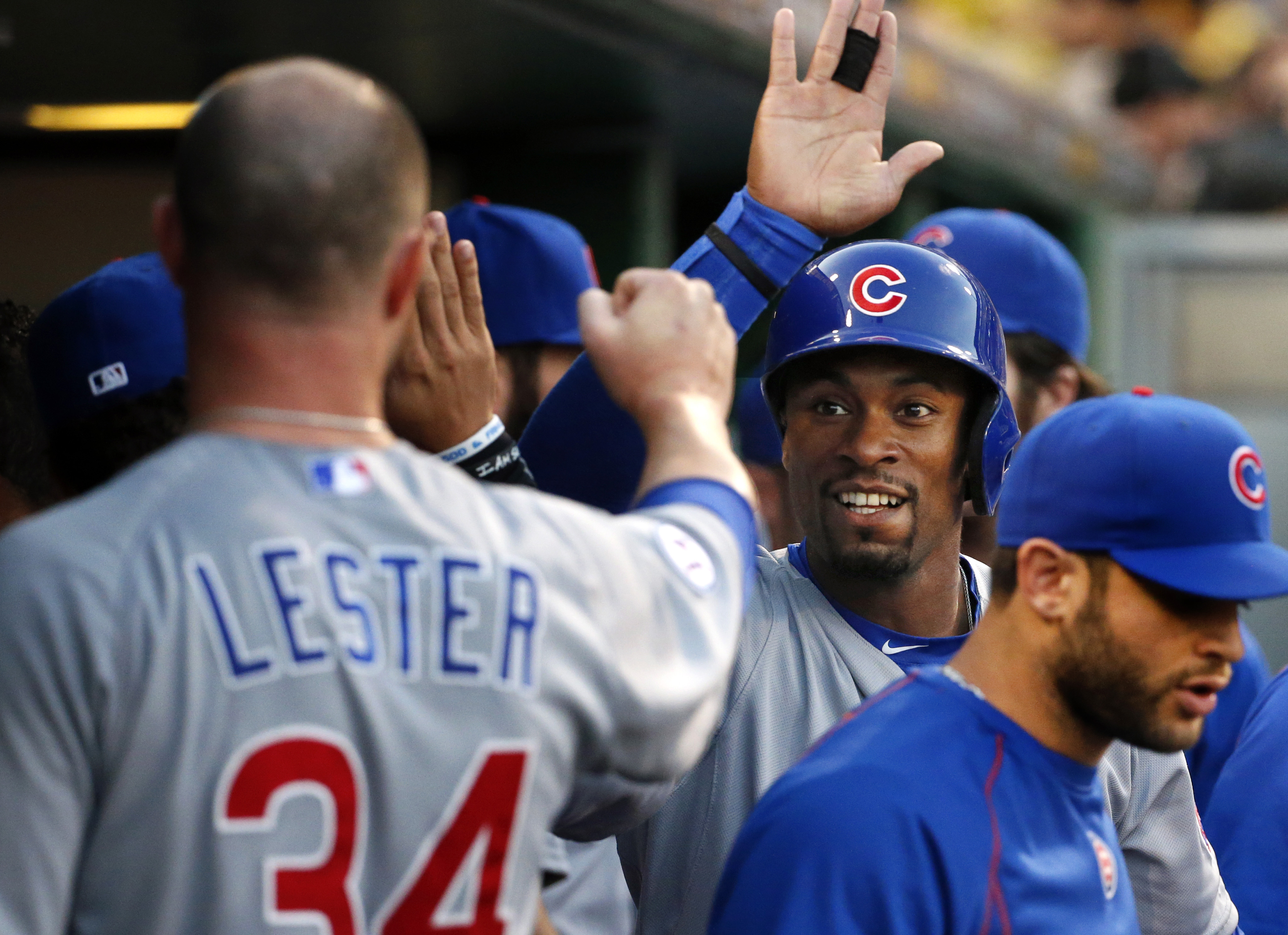 FILE - In this Tuesday, Sept. 15, 2015 file photo, Chicago Cubs' Austin Jackson, second right, celebrates with pitcher Jon Lester after scoring during the first inning of the second baseball game of a doubleheader against the Pittsburgh Pirates in Pittsbu