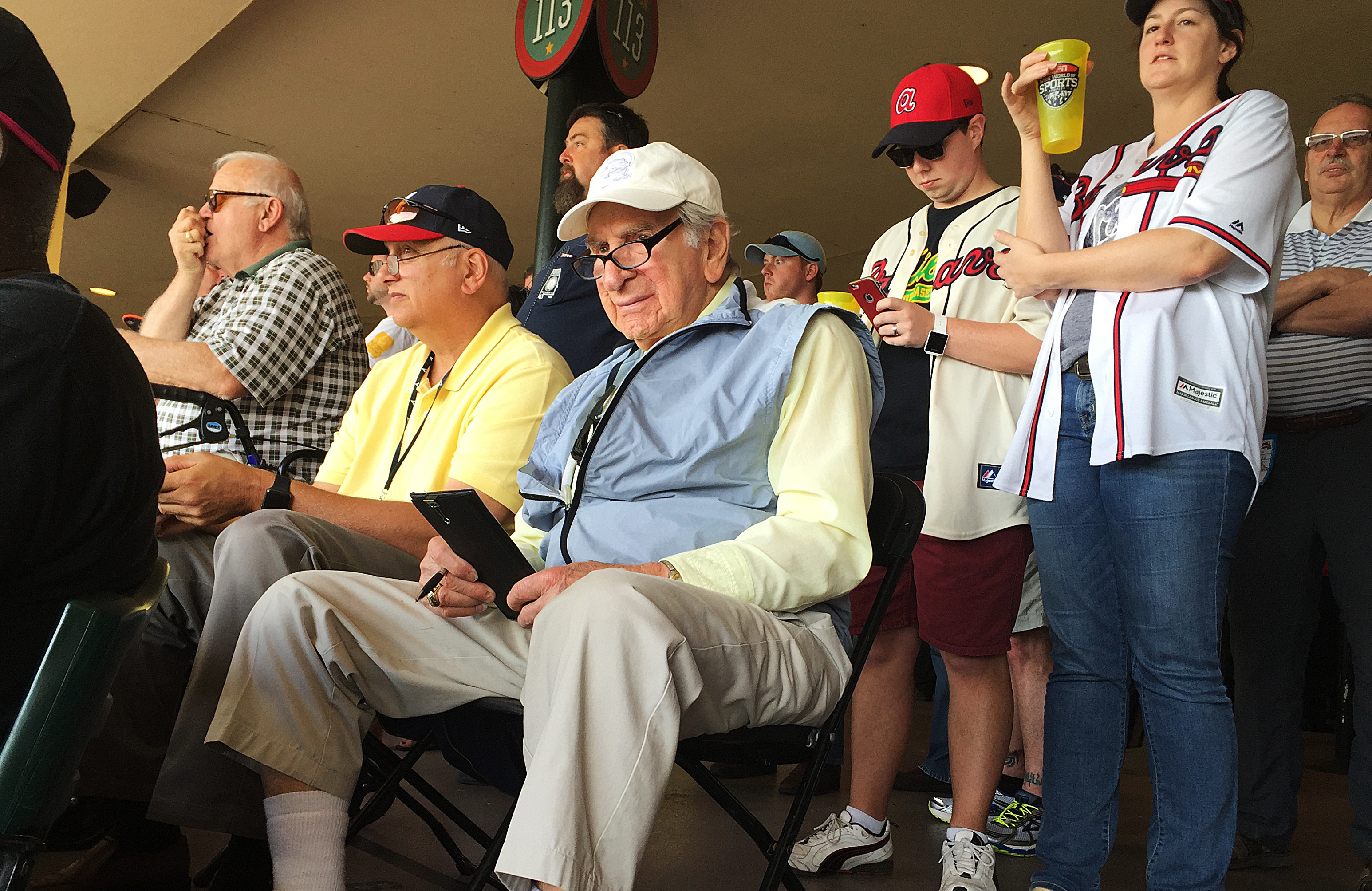 Tommy Giordano, special assistant to the general manager of the Atlanta Braves, scouts an exhibition spring training baseball game between the Braves and the Pittsburgh Pirates, Saturday, March 5, 2016, in Kissimmee, Fla. Giordano sits in a folding chair