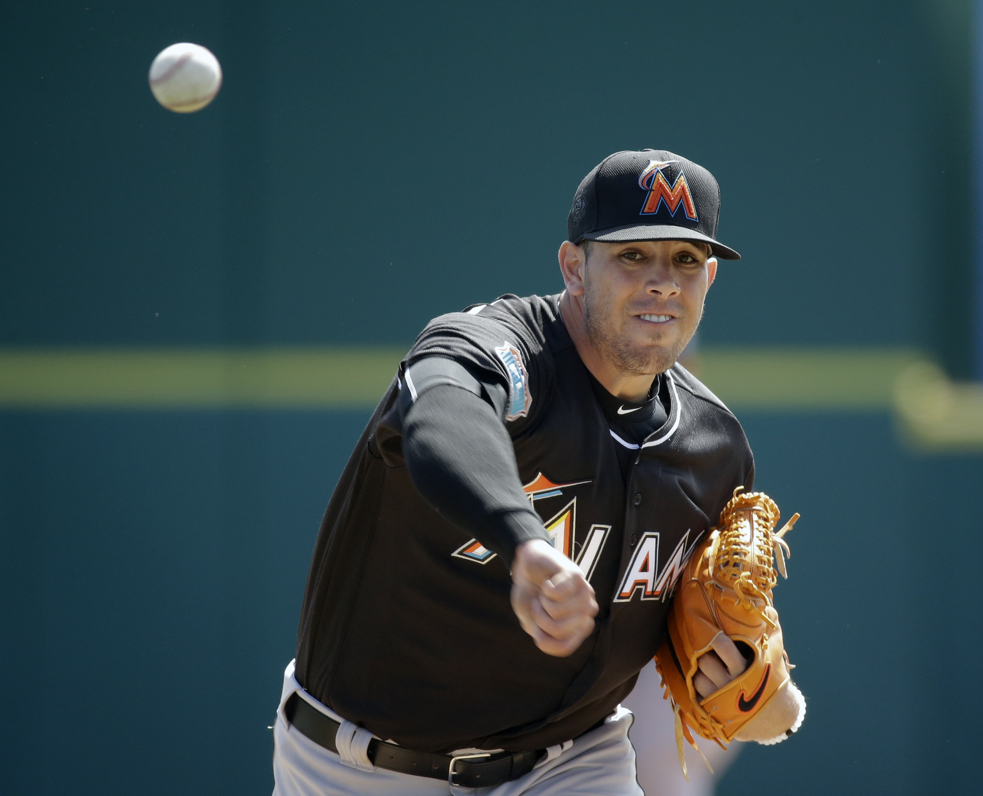 Miami Marlins starting pitcher Jose Fernandez throws in the first inning of a spring training baseball game against the Washington Nationals, Monday, March 7, 2016, in Viera, Fla. (AP Photo/John Raoux)