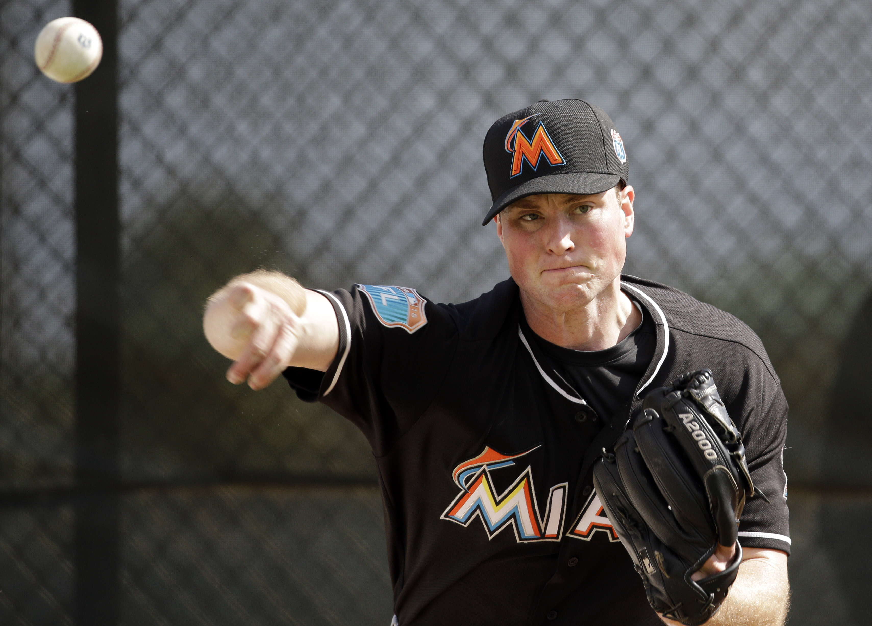 FILE - In this Feb. 22, 2016, file photo, Miami Marlins pitcher Carter Capps throws a bullpen session during spring training baseball practice in Jupiter, Fla. Miami Marlins reliever Carter Capps has a torn ligament in his throwing elbow that requires Tom
