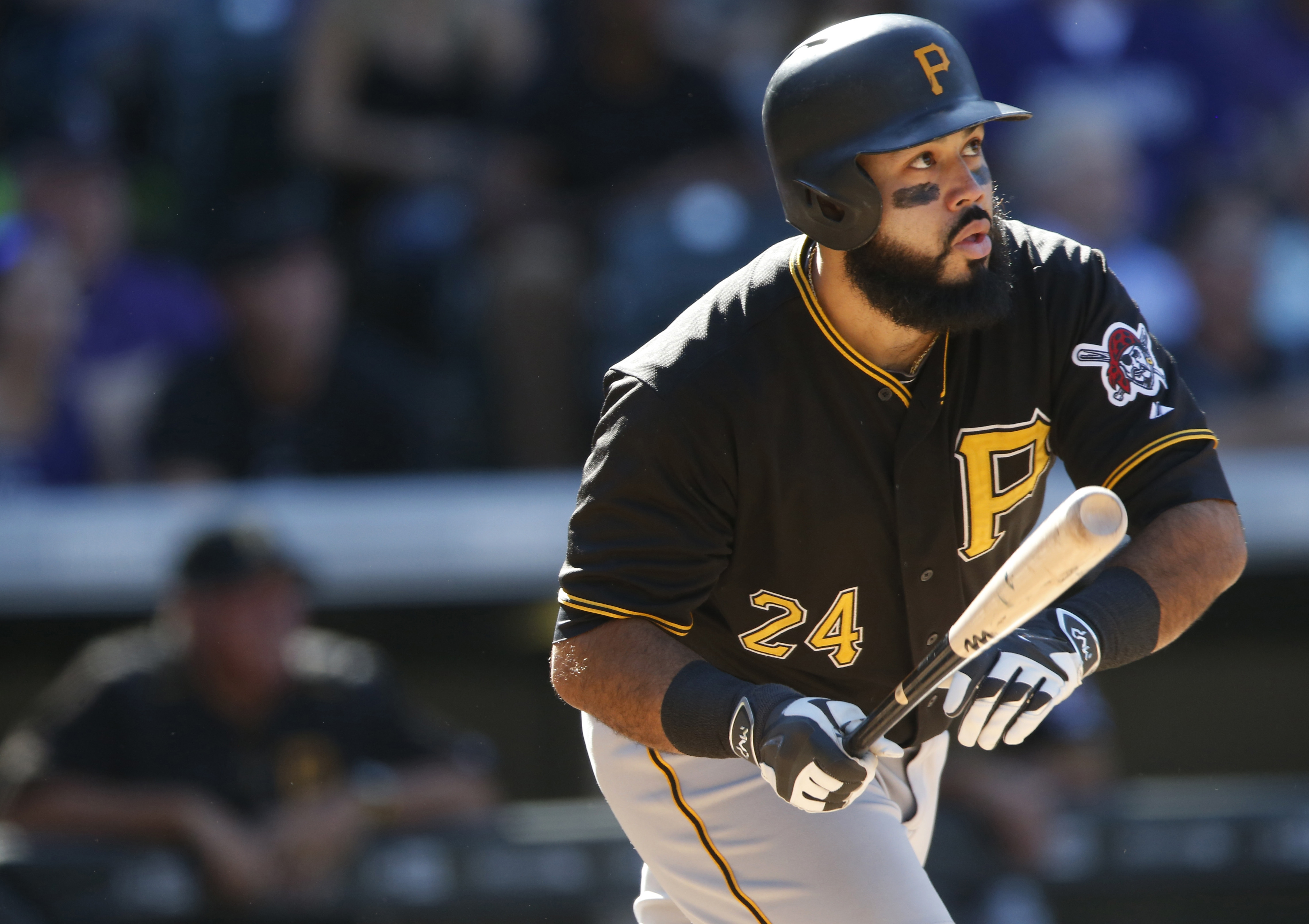 FILE - In this Sept. 24, 2015, file photo, Pittsburgh Pirates' Pedro Alvarez watches his three-run home run off Colorado Rockies relief pitcher Jairo Diaz during the eighth inning of a baseball game in Denver. A person familiar with the negotiations says