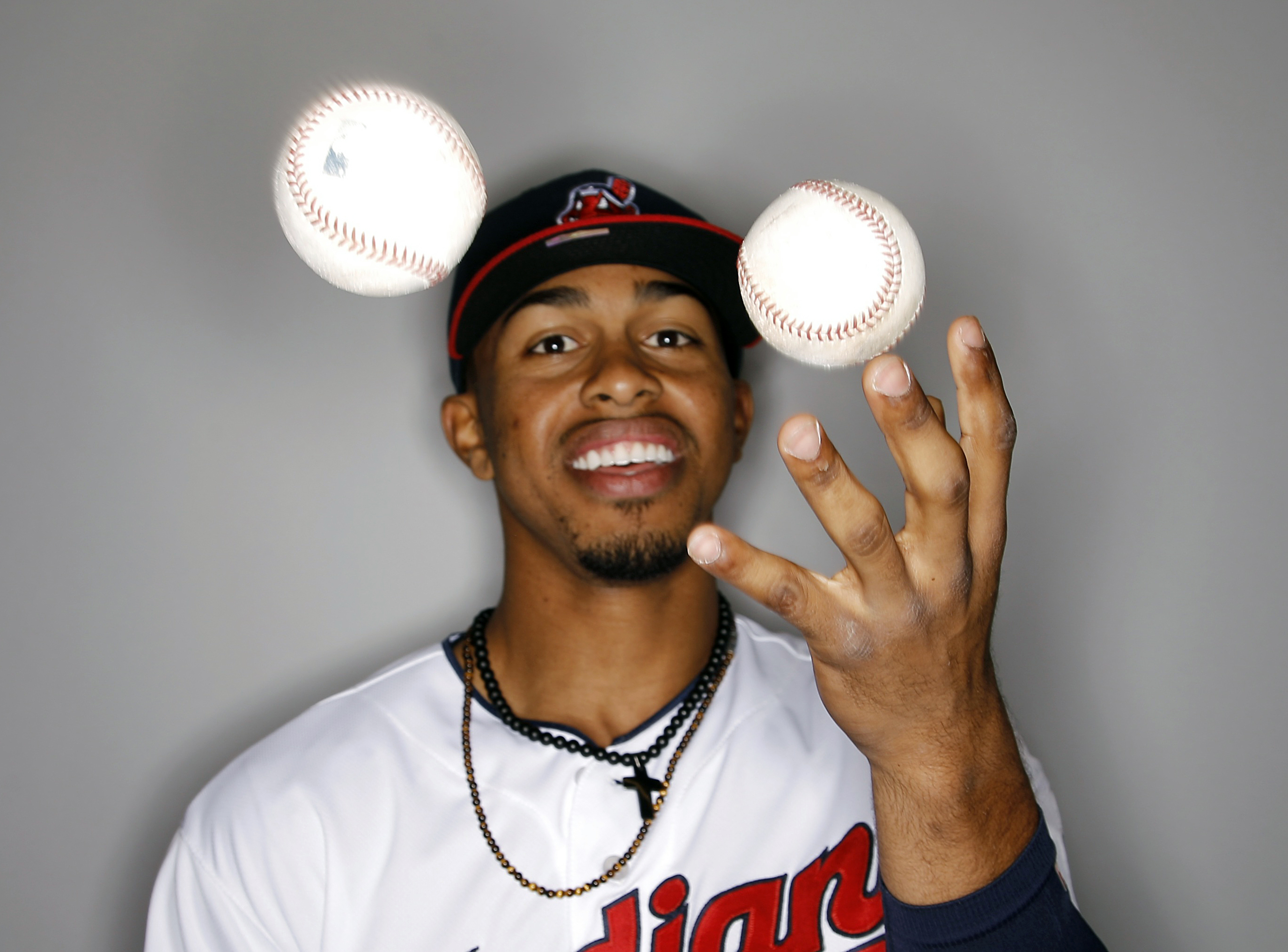 "FILE - In this Feb. 27, 2016, file photo, Cleveland Indians' Francisco Lindor juggles some baseballs during the team's photo day in Glendale, Ariz. ""I've always been the same little kid, running around, smiling, trying to mess with people a little bit,"" L"
