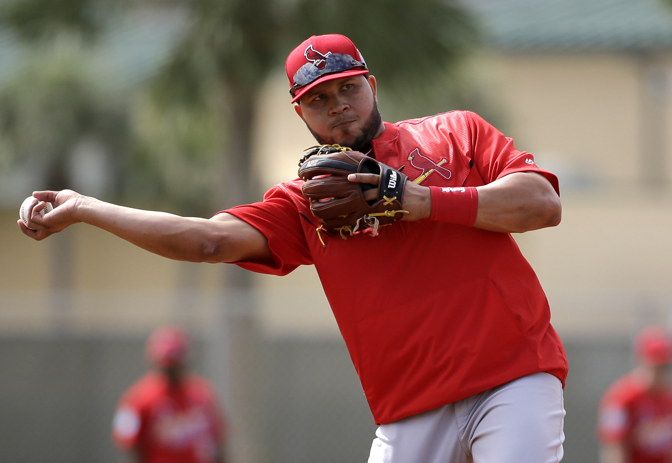 FILE - In this Feb. 23, 2016, file photo, St. Louis Cardinals shortstop Jhonny Peralta throws to first during spring training baseball practice in Jupiter, Fla. Peralta has undergone surgery for a left thumb injury and likely will be sidelined for about 1