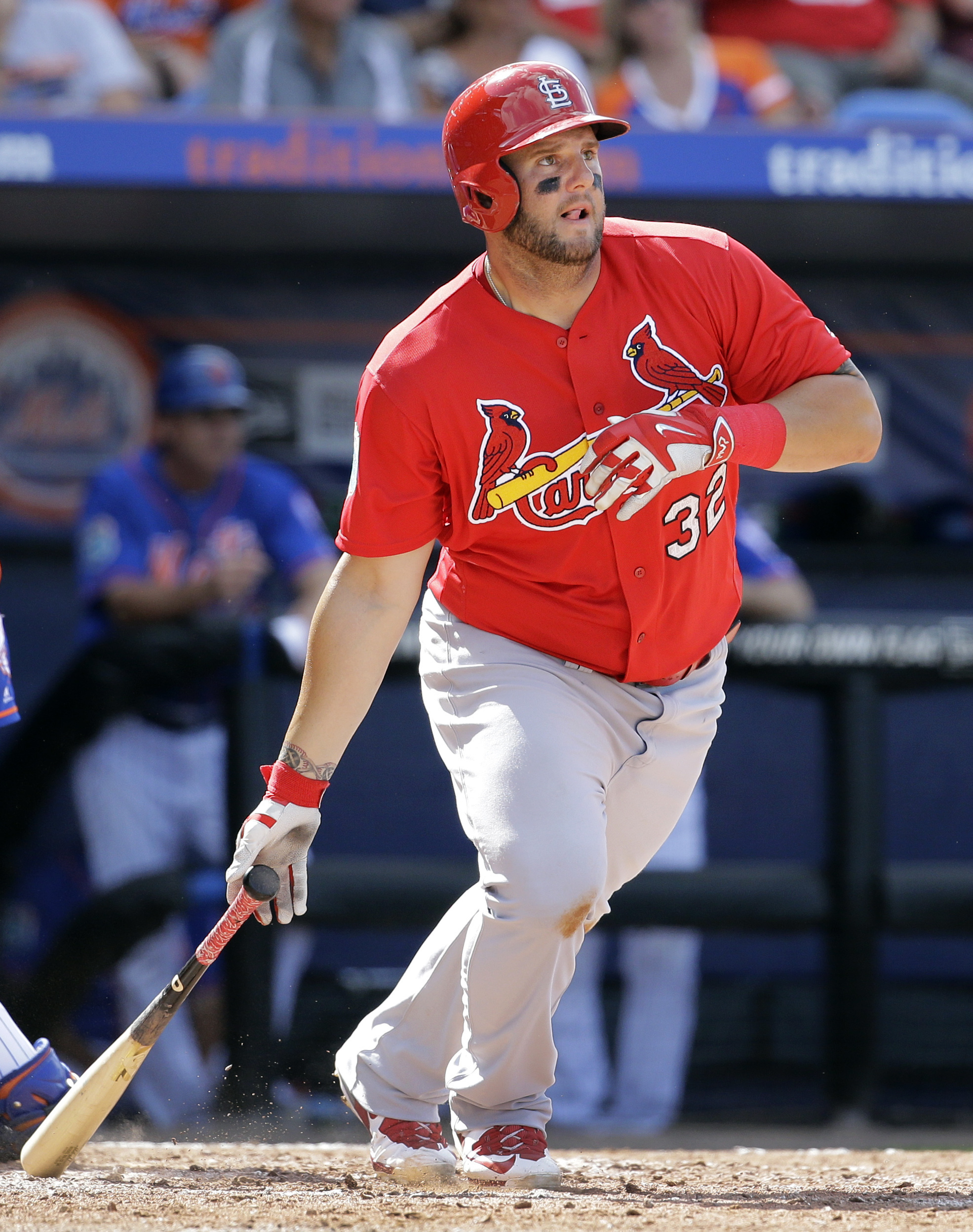 St. Louis Cardinals' Matt Adams watches his double during the sixth inning of an exhibition spring training baseball game against the New York Mets Thursday, March 10, 2016, in Port St. Lucie, Fla. (AP Photo/Jeff Roberson)