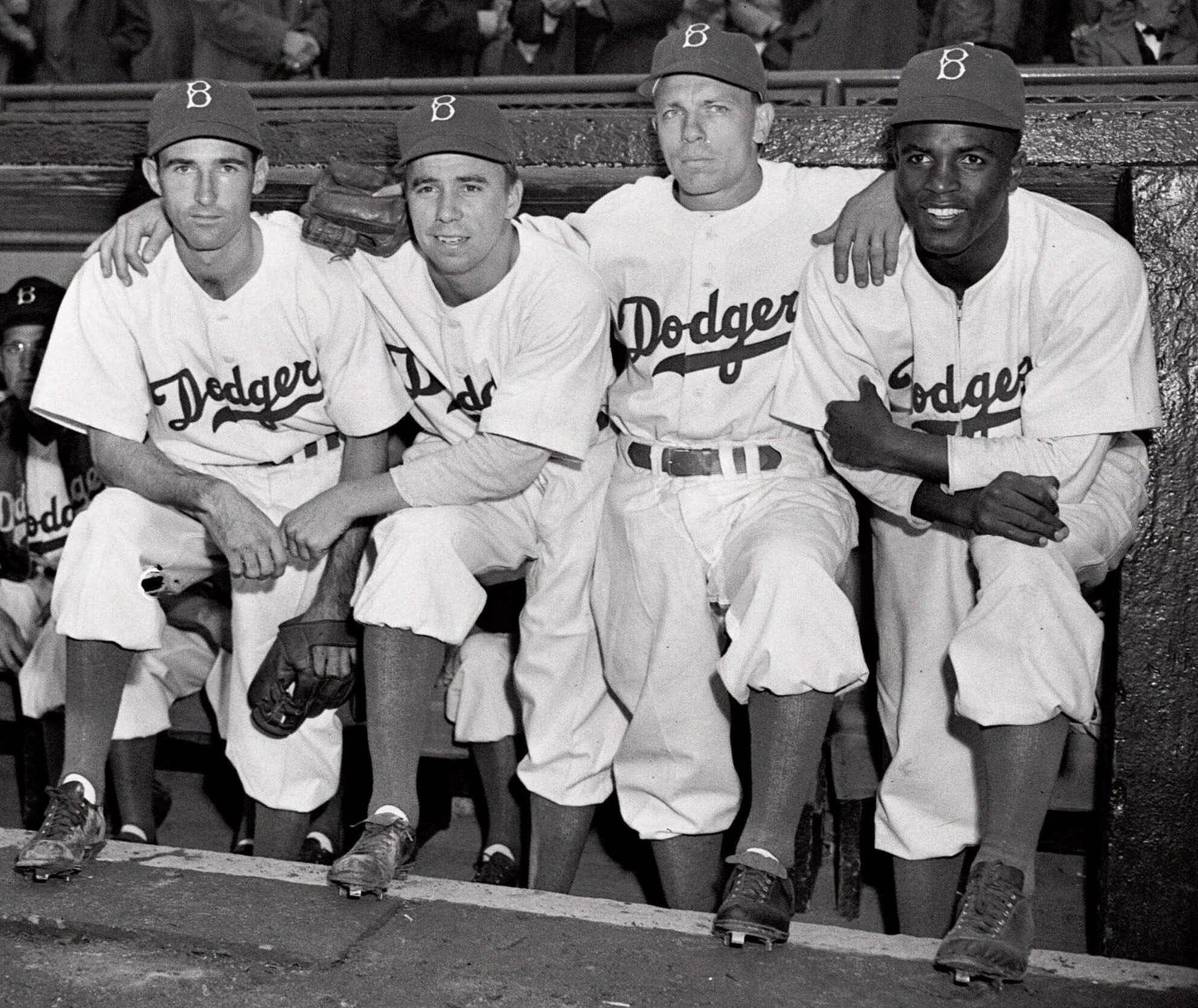 FILE - In this April 15, 1947 file photo, from left, Brooklyn Dodgers baseball players John Jorgensen, Pee Wee Reese, Ed Stanky and Jackie Robinson pose at Ebbets Field in New York. The ghosts of Dodgertown are everywhere. Along the narrow roads winding t
