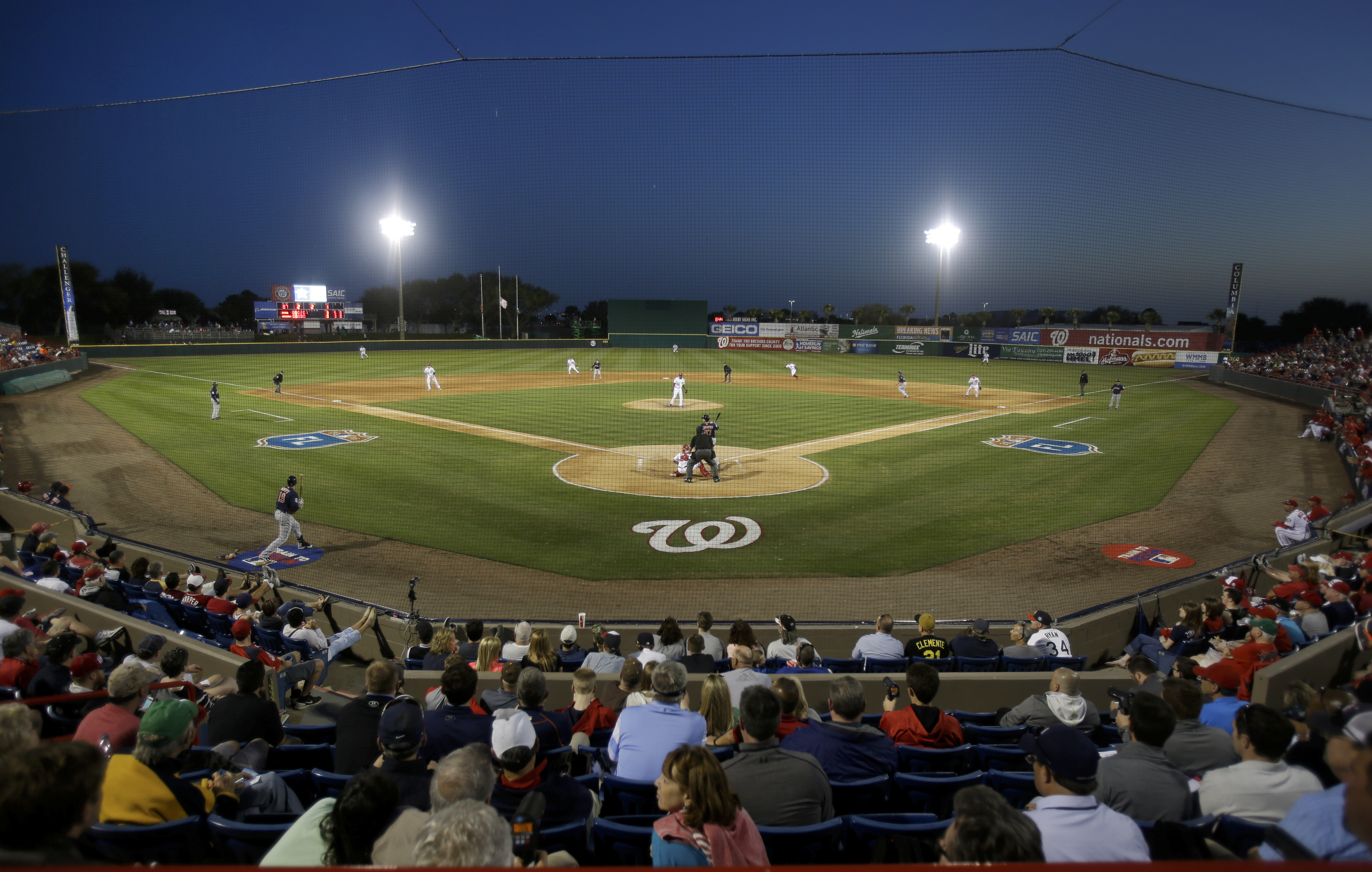 Fans watch a spring training baseball game between the Washington Nationals and the Houston Astros, Thursday, March 10, 2016, in Viera, Fla. (AP Photo/John Raoux)