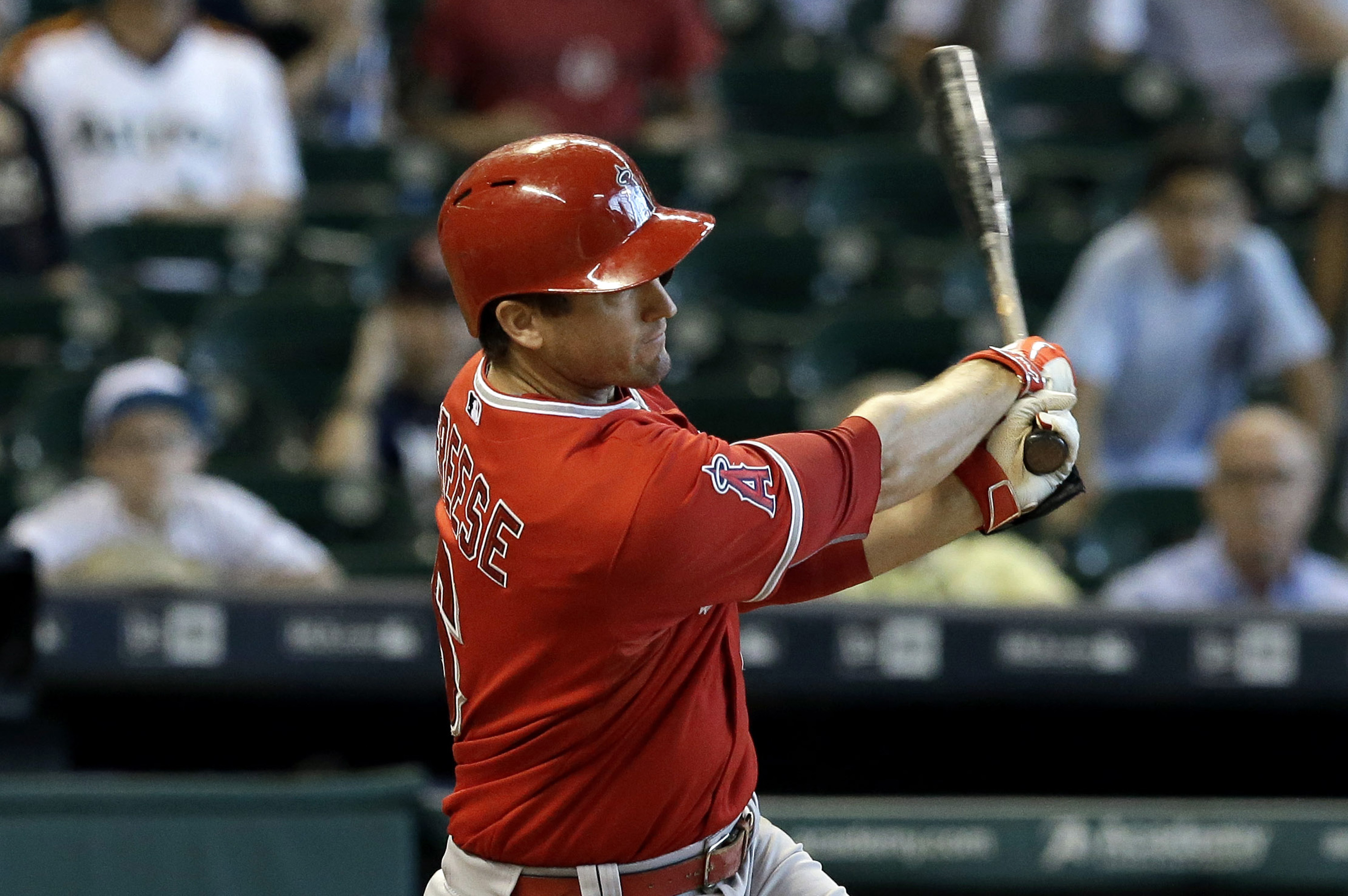 FILE - In this Sept. 23, 2015, file photo, Los Angeles Angels' David Freese hits a two-run double against the Houston Astros to put the Angels ahead in the eighth inning of a baseball game in Houston. Freese and the Pittsburgh Pirates have agreed to a $3