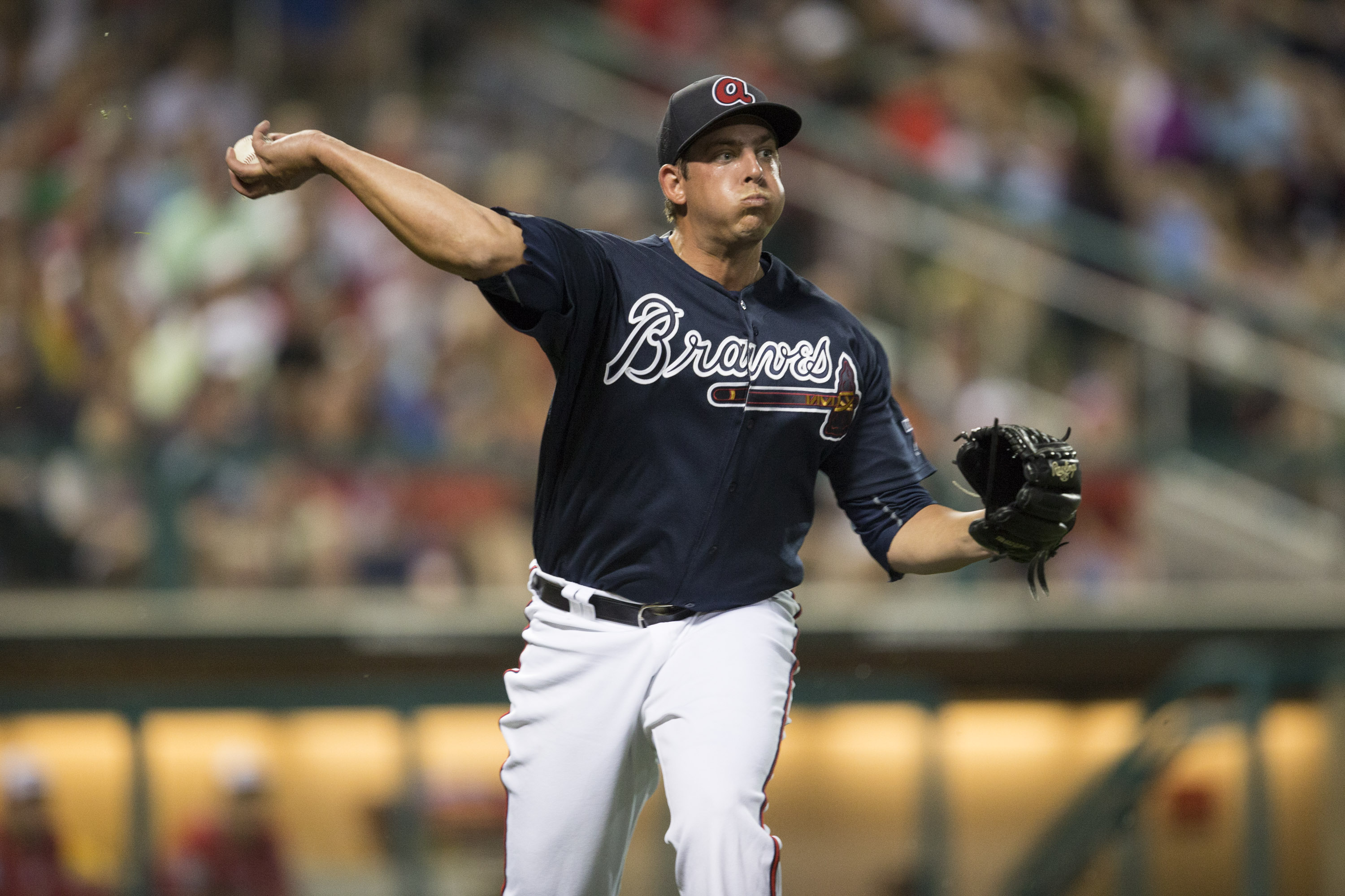Atlanta Braves pitcher Aaron Blair fields the ball and throws out the runner during a spring training baseball game against the Washington Nationals, Saturday, March 12, 2016, in Kissimmee, Fla. (AP Photo/Willie J. Allen Jr.)