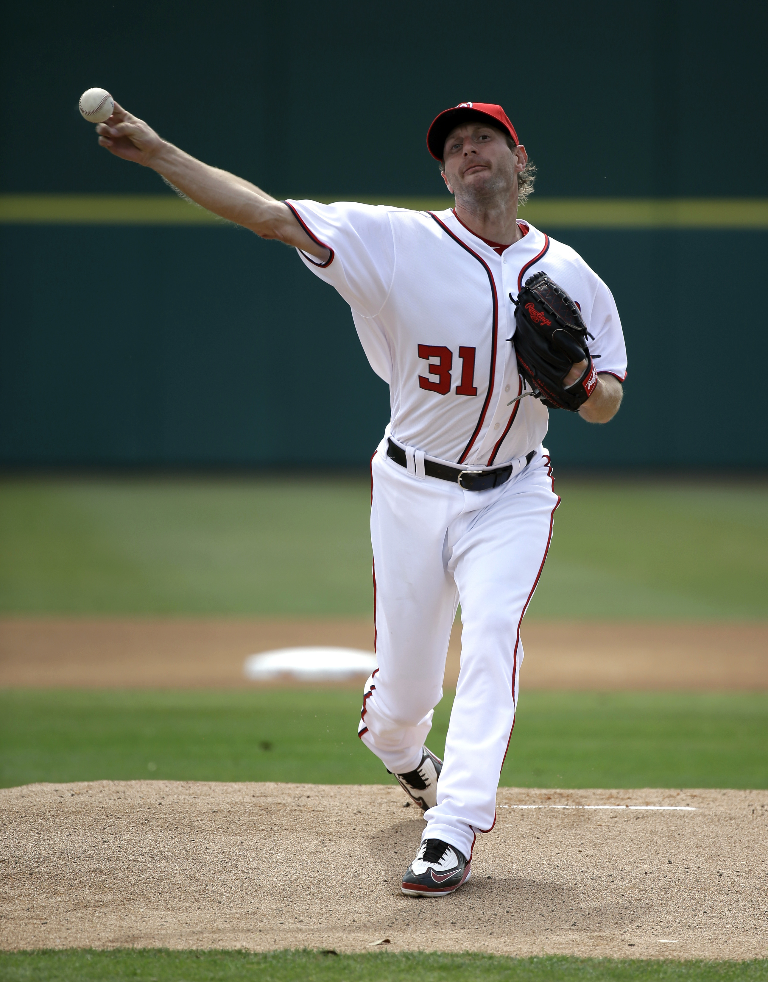Washington Nationals' Max Scherzer (31) throws in the first inning of a spring training baseball game against the St. Louis Cardinals, Sunday, March 13, 2016, in Viera, Fla. (AP Photo/John Raoux)