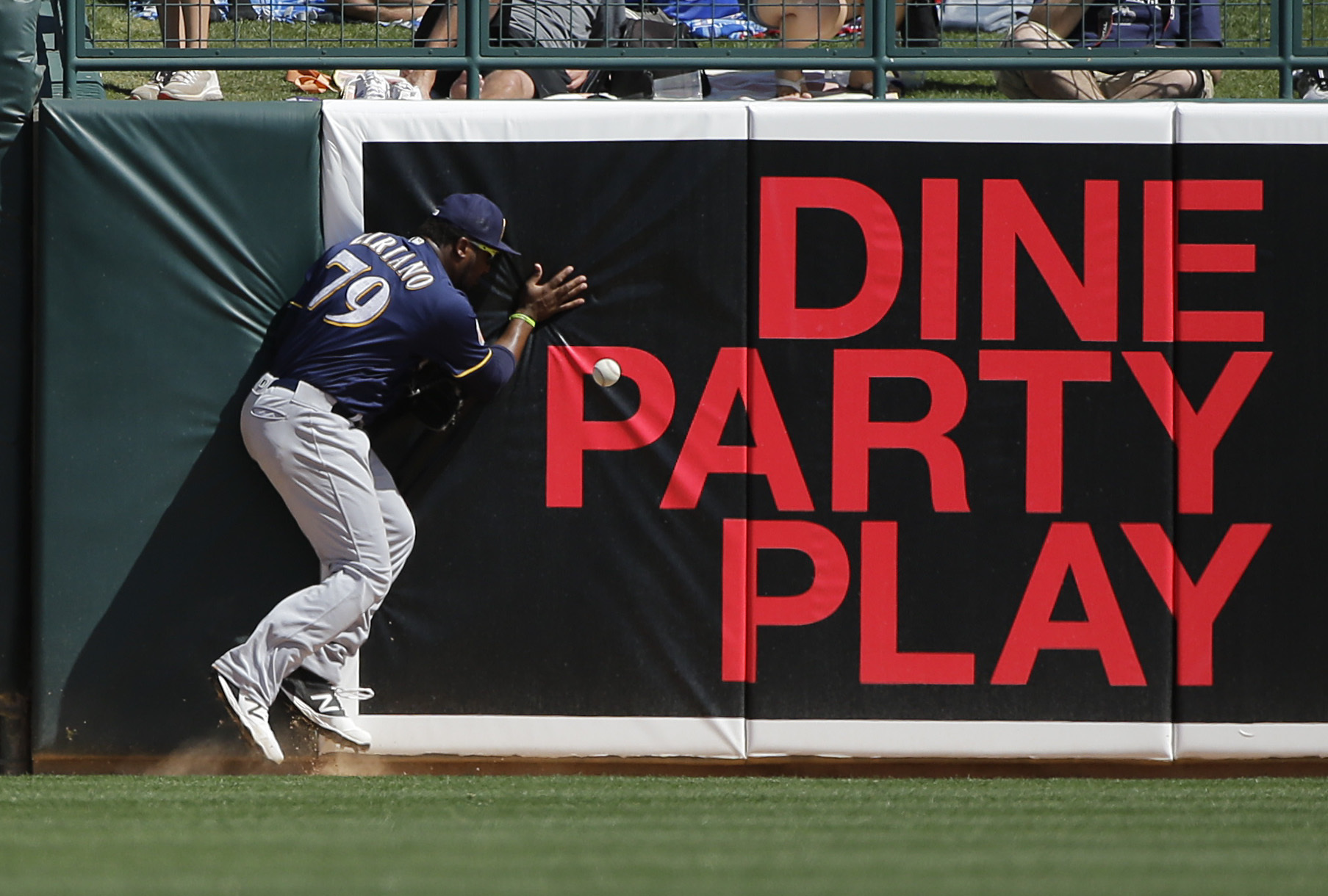 Milwaukee Brewers' Rymer Liriano, cannot catch an RB-double hit by Los Angeles Dodgers' Adrian Gonzalez during the third inning of a spring training baseball game Monday, March 14, 2016, in Phoenix. (AP Photo/Jae C. Hong)