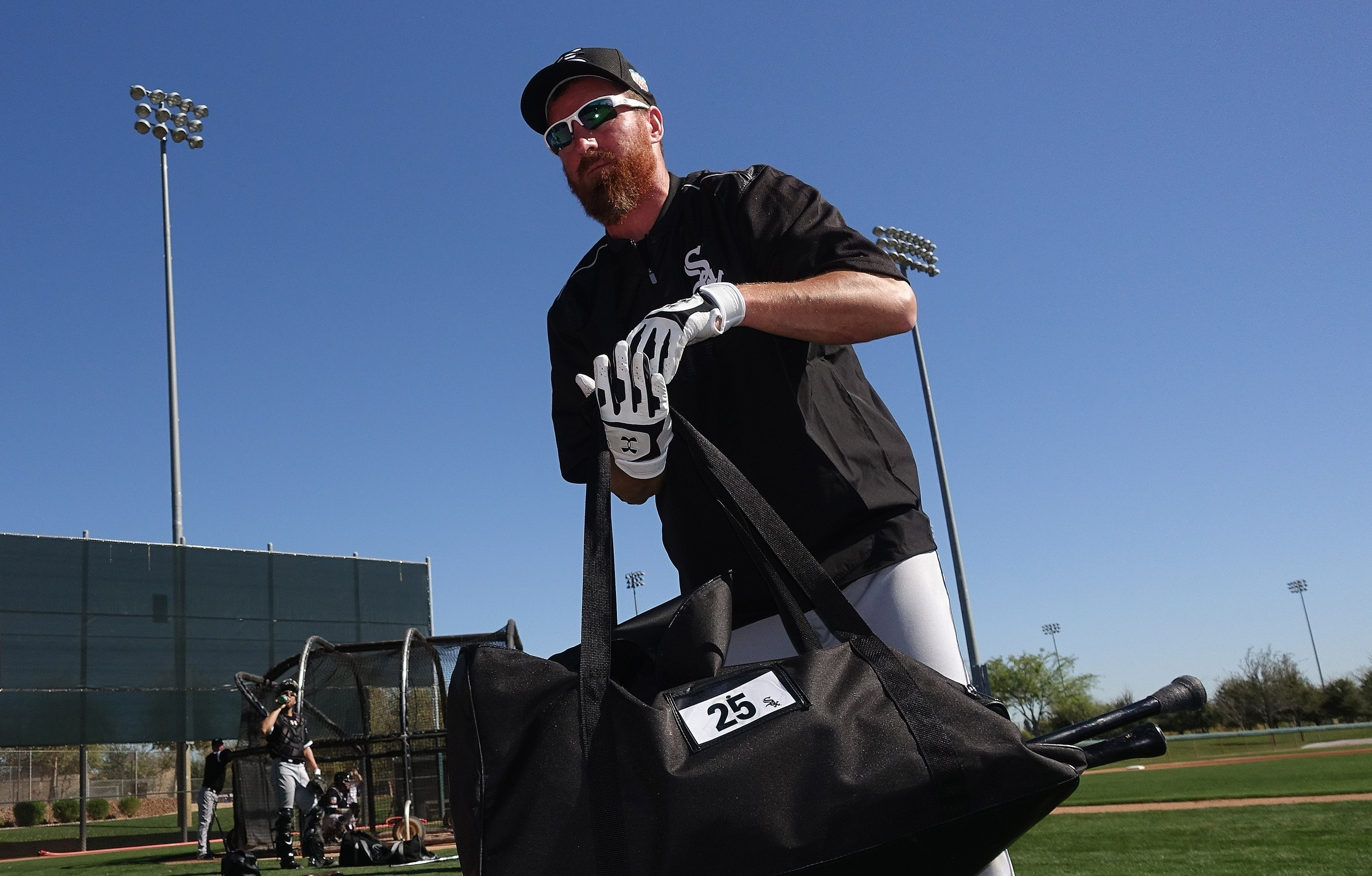 FILE - In this Feb. 26, 2016, file photo, Chicago White Sox's Adam LaRoche picks up his gear after taking live batting practice during a spring training baseball workout in Glendale, Ariz. LaRoche surprised the White Sox by retiring Tuesday, March 15, 201