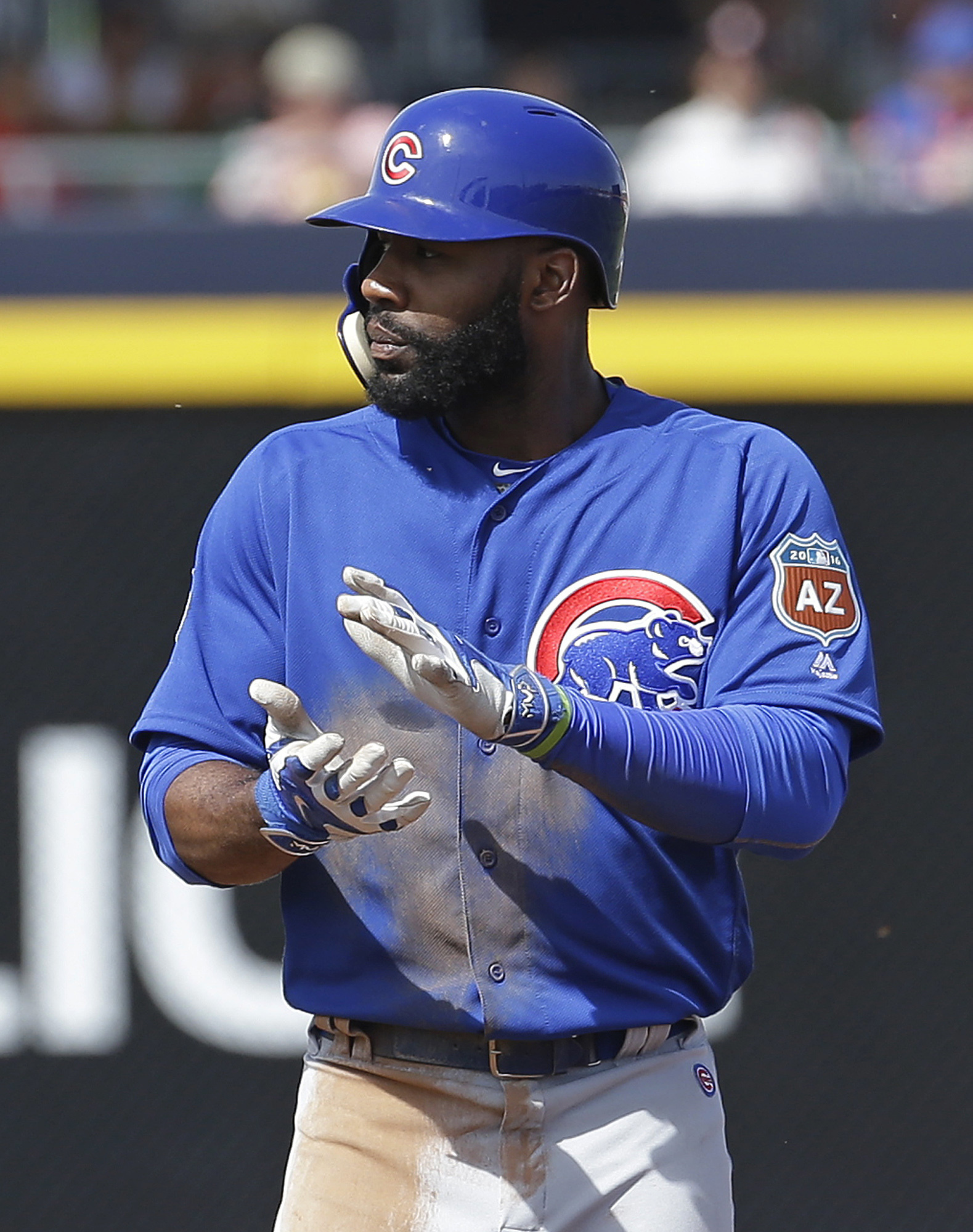 Chicago Cubs' Jason Heyward claps after hitting a three-run double during the third inning of a spring training baseball game against the San Diego Padres on Tuesday, March 15, 2016, in Peoria, Ariz. (AP Photo/Darron Cummings)