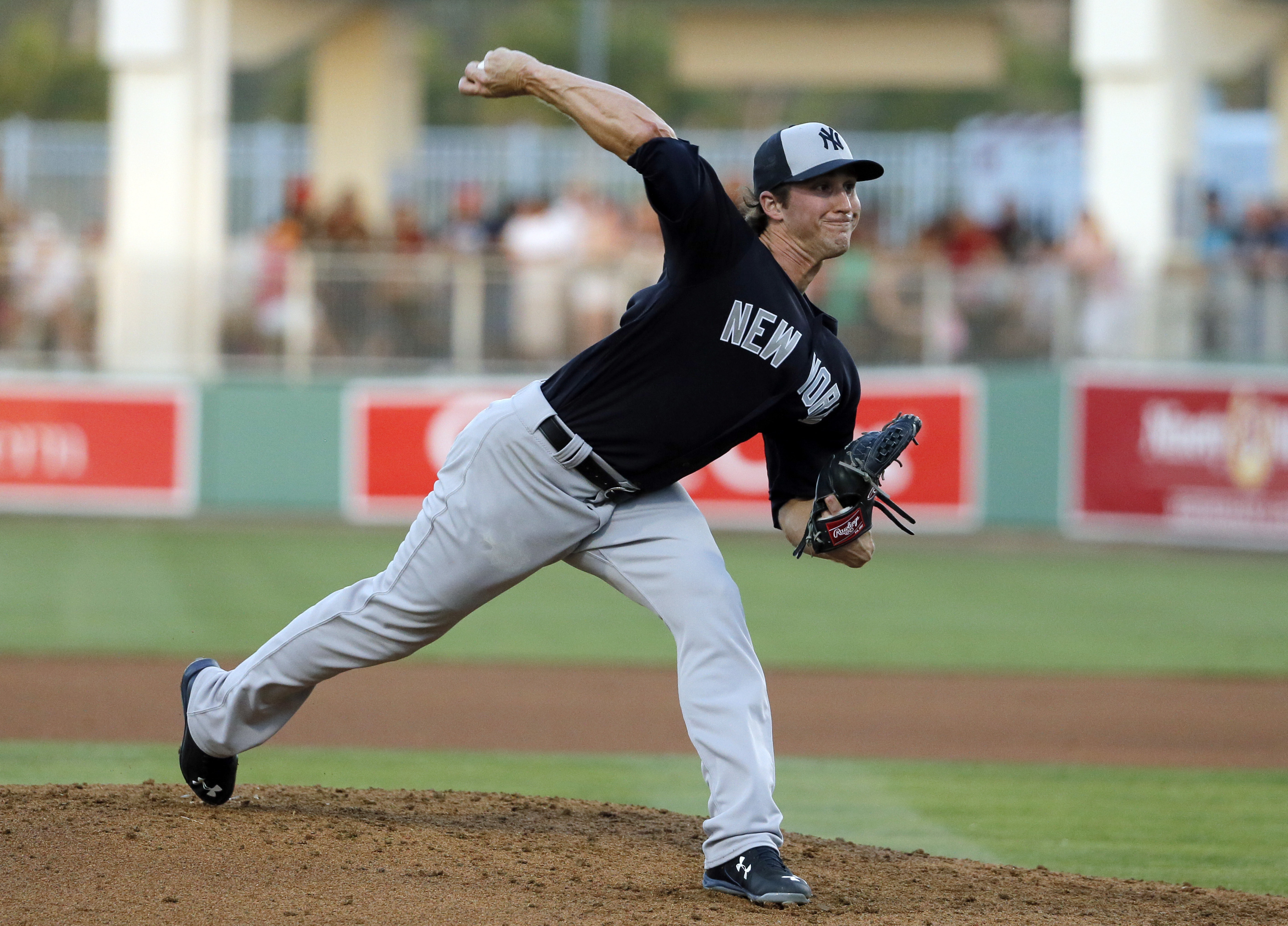 New York Yankees relief pitcher Bryan Mitchell (55) works against the Boston Red Sox in the fifth inning of a spring training baseball game, Tuesday, March 15, 2016, in Fort Myers, Fla. (AP Photo/Tony Gutierrez)