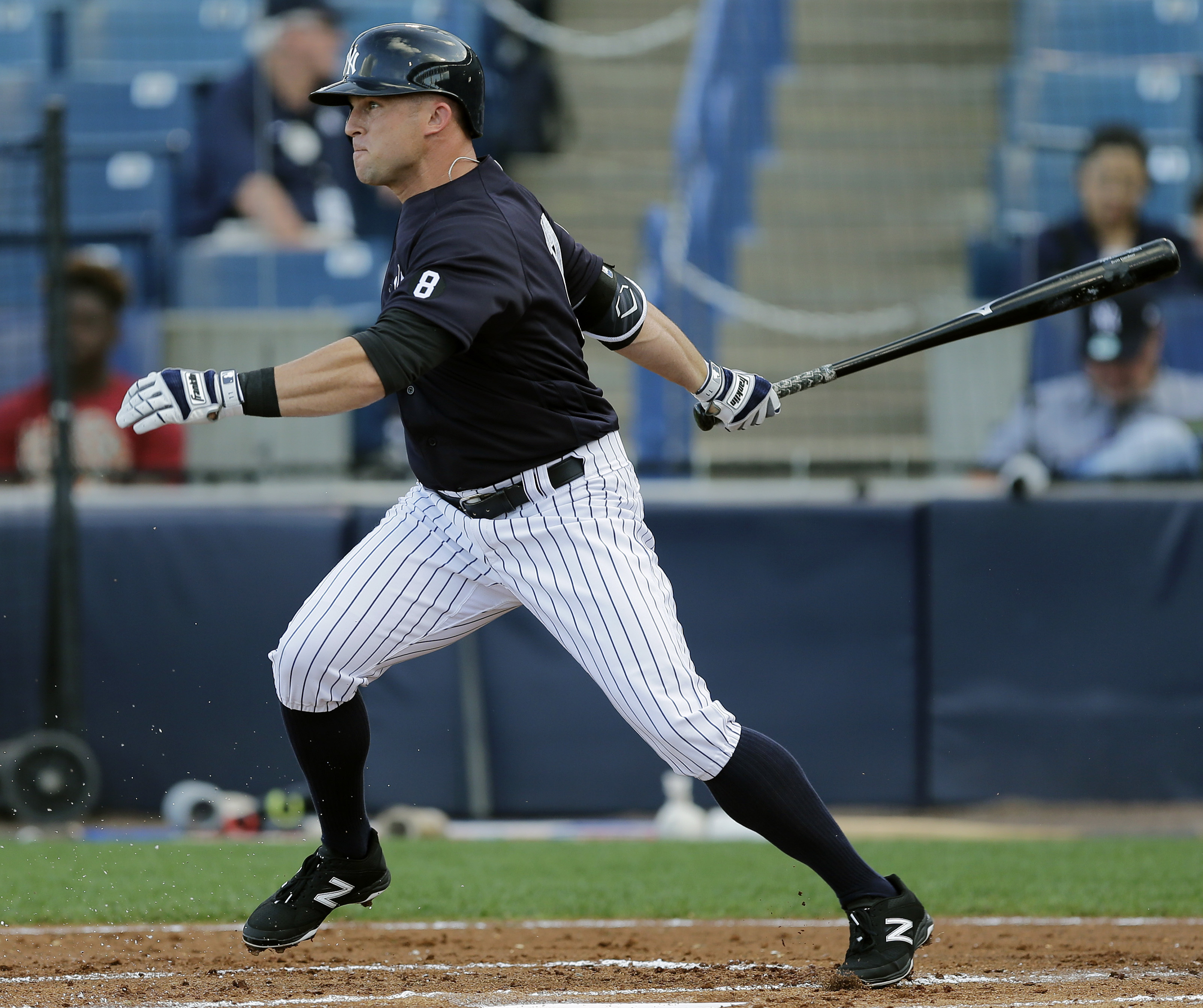 New York Yankees' Brett Gardner grounds out to Toronto Blue Jays second baseman Darwin Barney during the first inning of a spring training baseball game, Wednesday, March 16, 2016, in Tampa, Fla. Garner is making his spring debut. (AP Photo/Chris O'Meara)