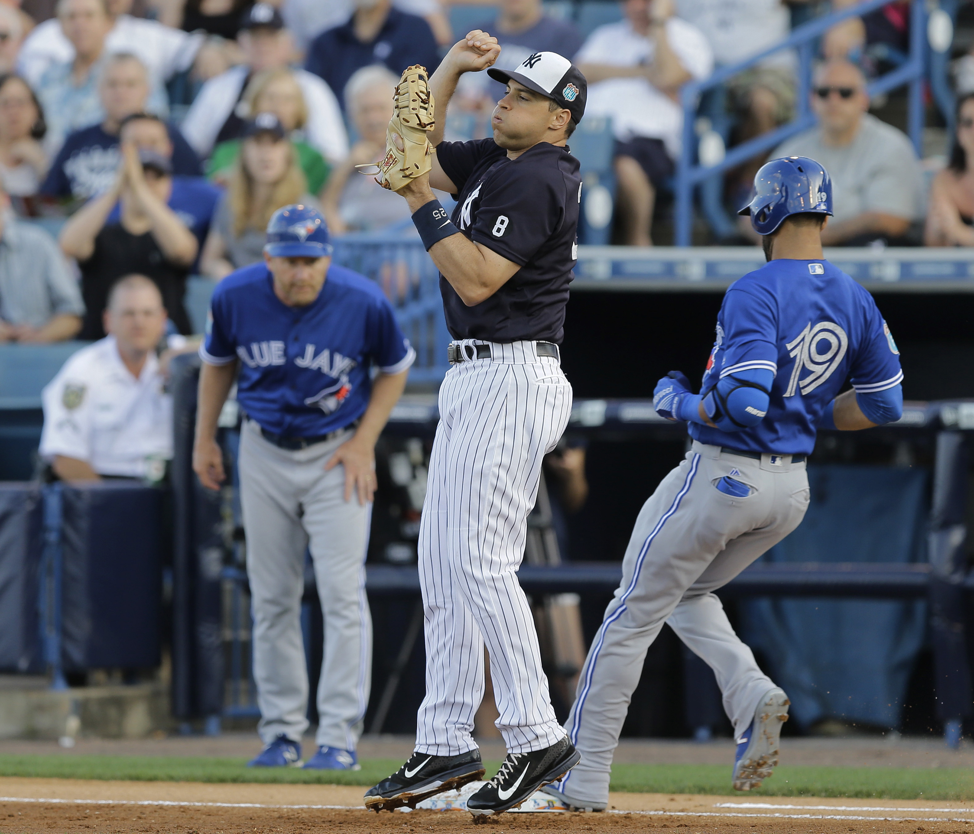 New York Yankees first baseman Mark Teixeira reacts as he gets out of the way after getting Toronto Blue Jays' Jose Bautista out at first base during the first inning of a spring training baseball game, Wednesday, March 16, 2016, in Tampa, Fla. (AP Photo/