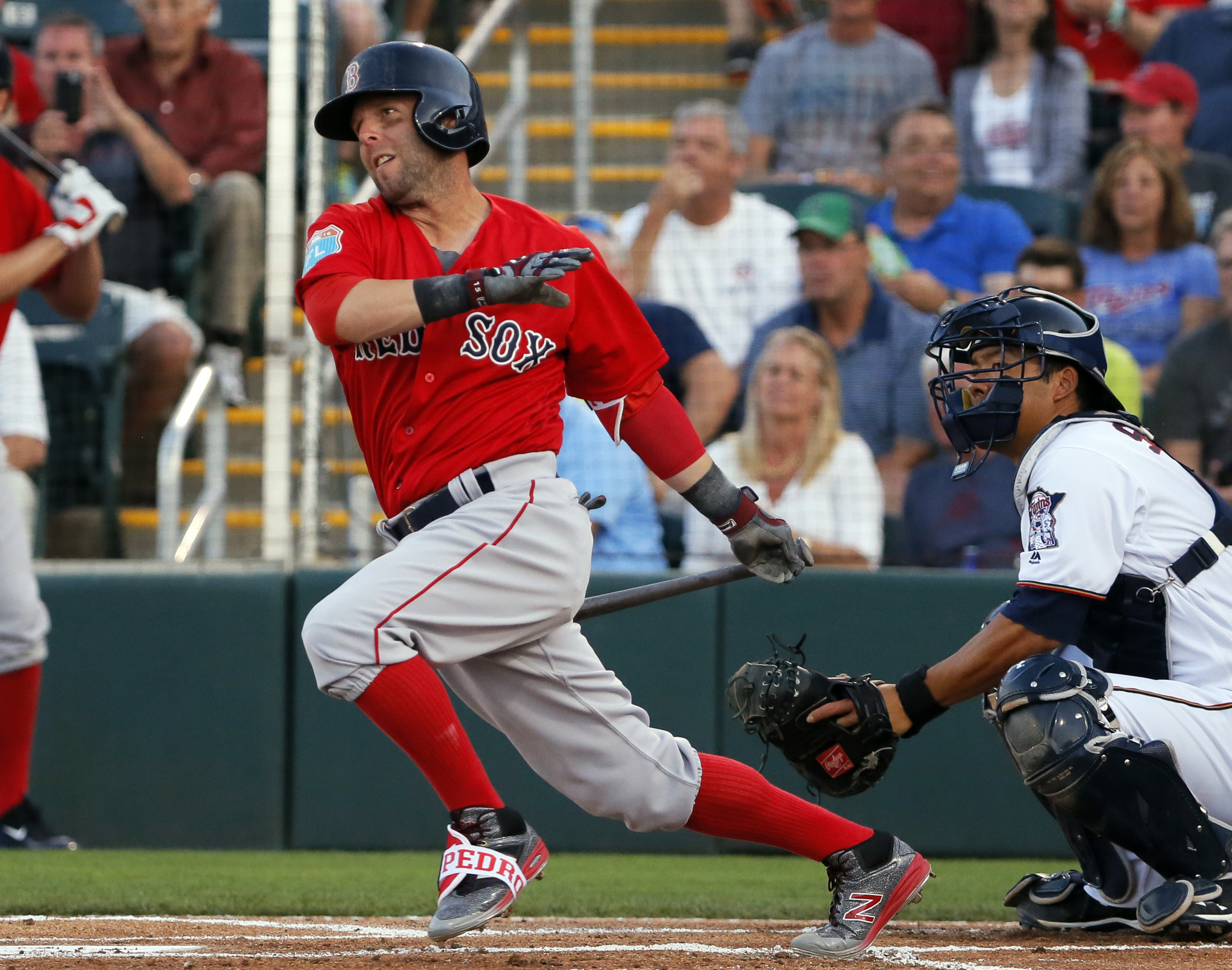 Boston Red Sox's Dustin Pedroia follows through on a ground-out in the first inning of a spring training baseball game as Minnesota Twins catcher Kurt Suzuki watches, Wednesday, March 16, 2016, in Fort Myers, Fla. The Twins won 9-4. (AP Photo/Tony Gutierr