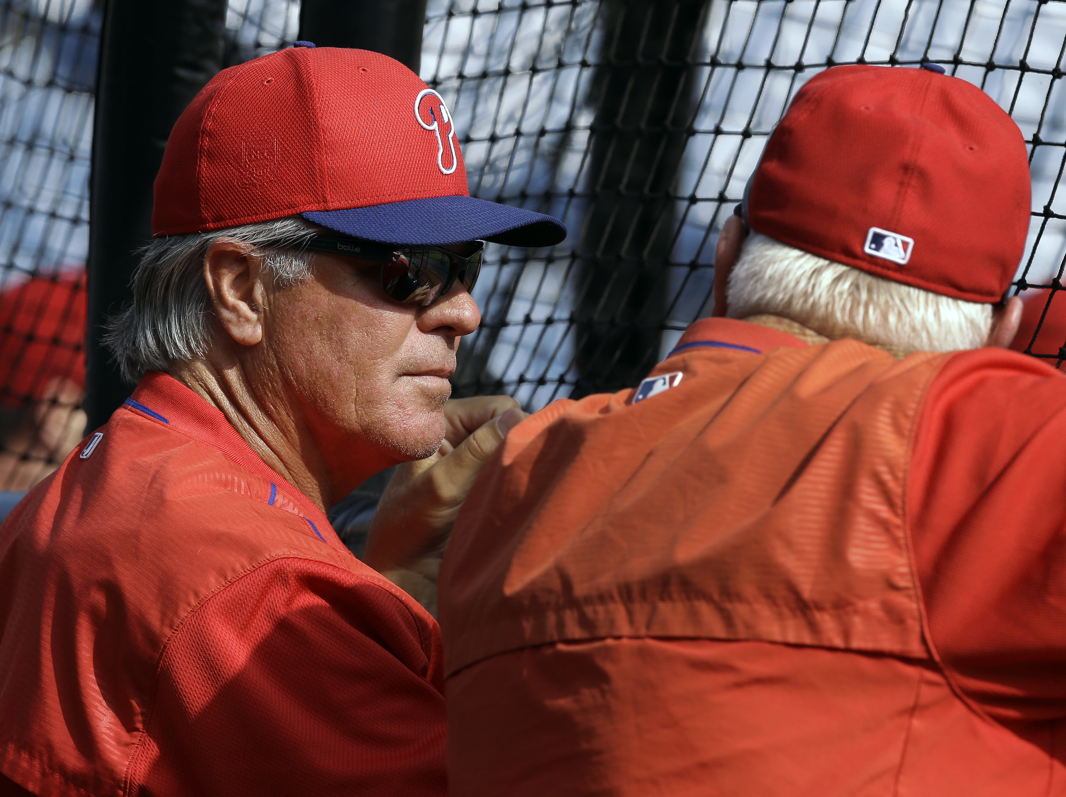 Philadelphia Phillies manager Pete Mackanin, left, talks with former manager Charlie Manuel before a spring training baseball game against the Tampa Bay Rays, Thursday, March 17, 2016, in Clearwater, Fla. (AP Photo/Chris O'Meara)