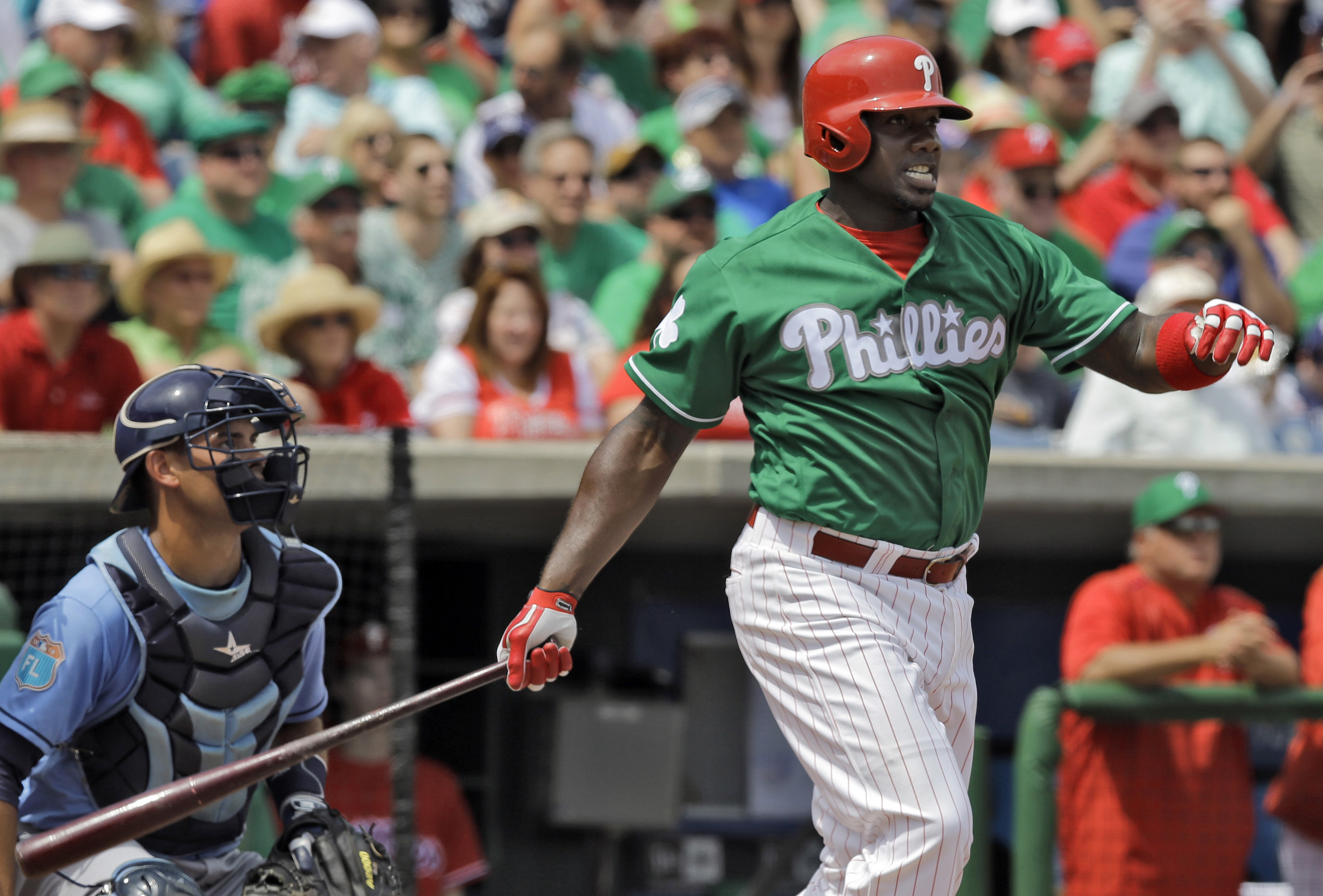 Philadelphia Phillies' Ryan Howard follows through on a double off Tampa Bay Rays starting pitcher Matt Moore during the second inning of a spring training baseball game Thursday, March 17, 2016, in Clearwater, Fla. Catching for the Rays is Luke Maile. (A