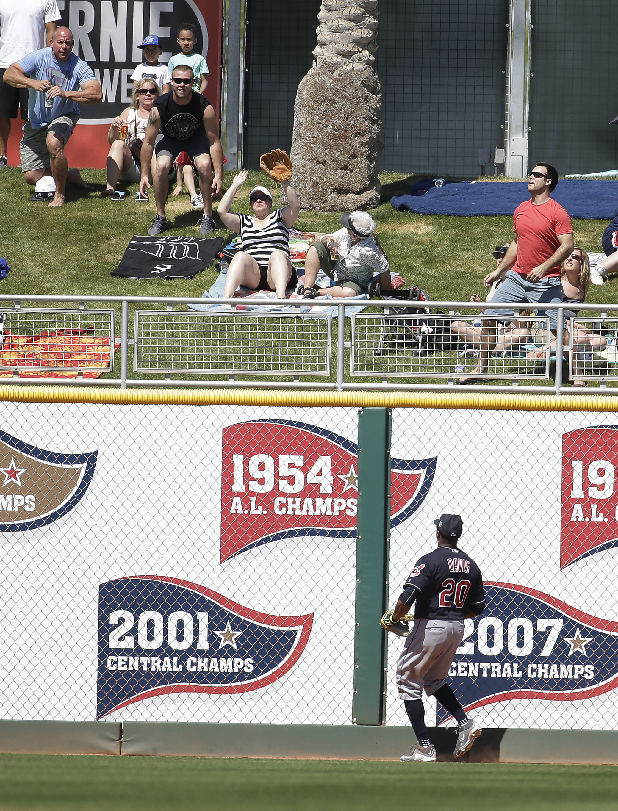 Cleveland Indians' Rajai Davis watches a two-run home run by Cincinnati Reds' Devin Mesoraco during the first inning of a spring training baseball game on Thursday, March 17, 2016, in Goodyear, Ariz. (AP Photo/Darron Cummings)