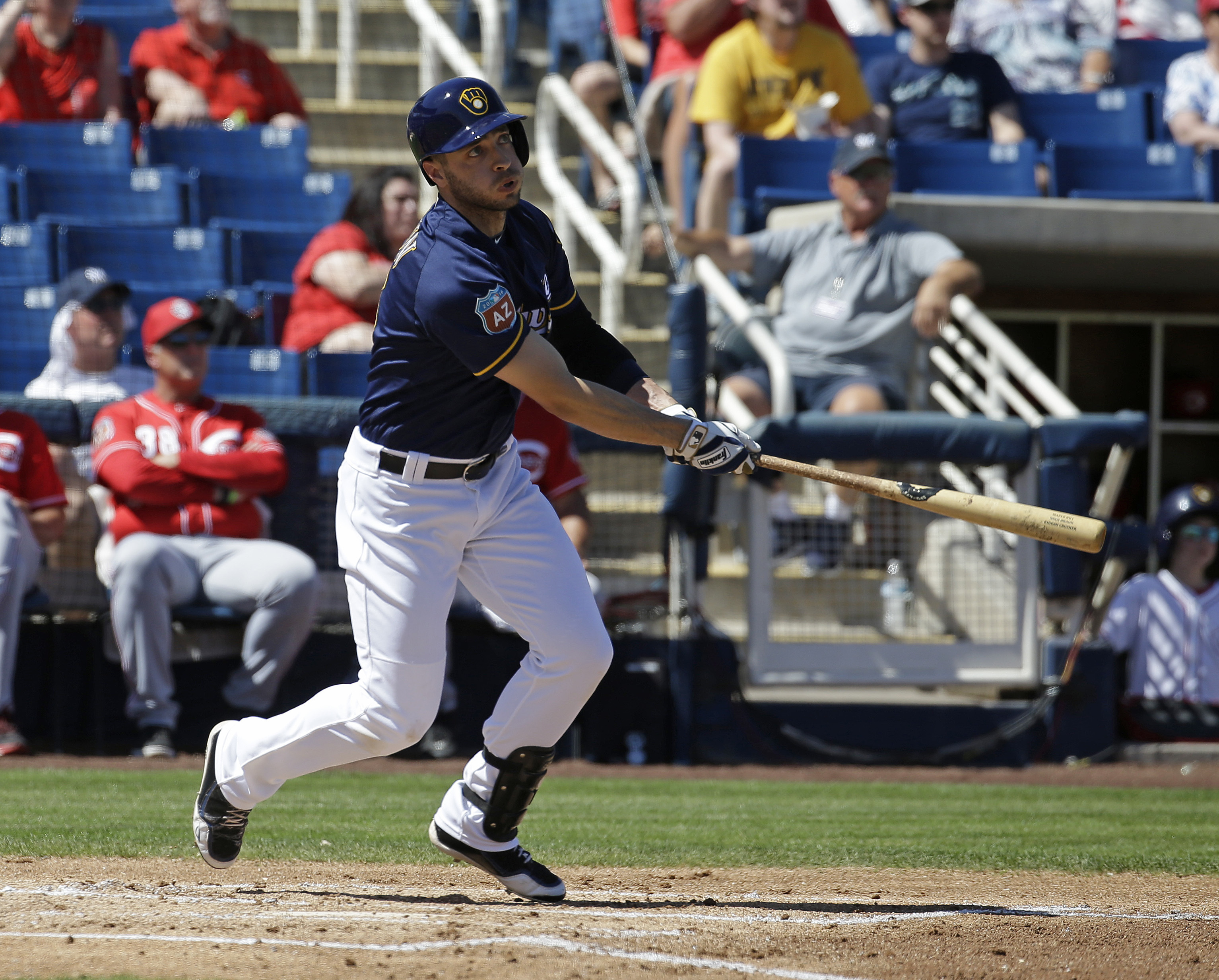 Milwaukee Brewers' Ryan Braun hits and RBI double during the first inning of a spring training baseball game against the Cincinnati Reds on Friday, March 18, 2016, in Phoenix. (AP Photo/Darron Cummings)