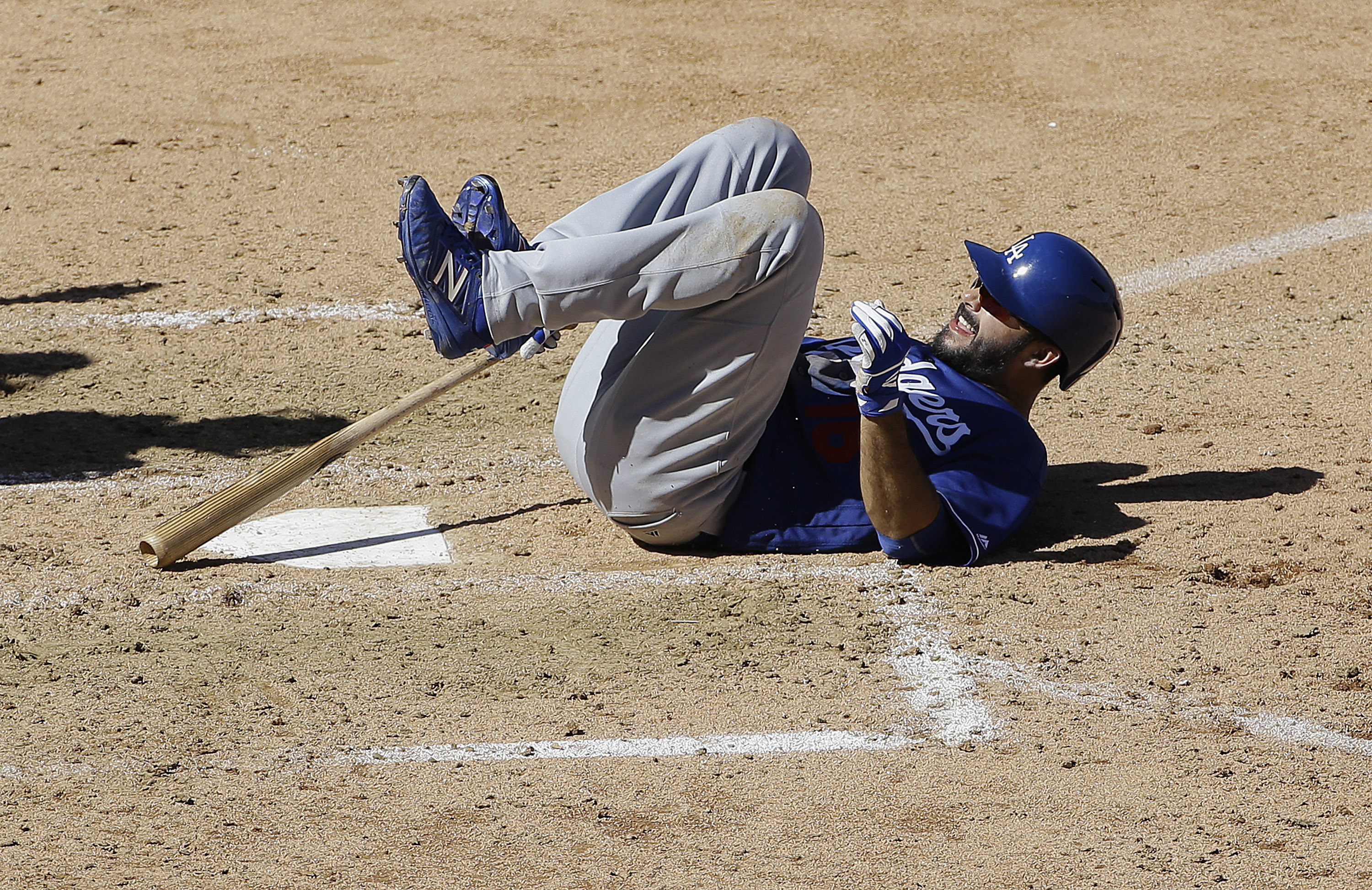 Los Angeles Dodgers' Andre Ethier rolls on the ground during the fourth inning of a spring training baseball game against the Arizona Diamondbacks in Scottsdale, Ariz., Friday, March 18, 2016. Ethier left the game after reaching first base on a walk. (AP