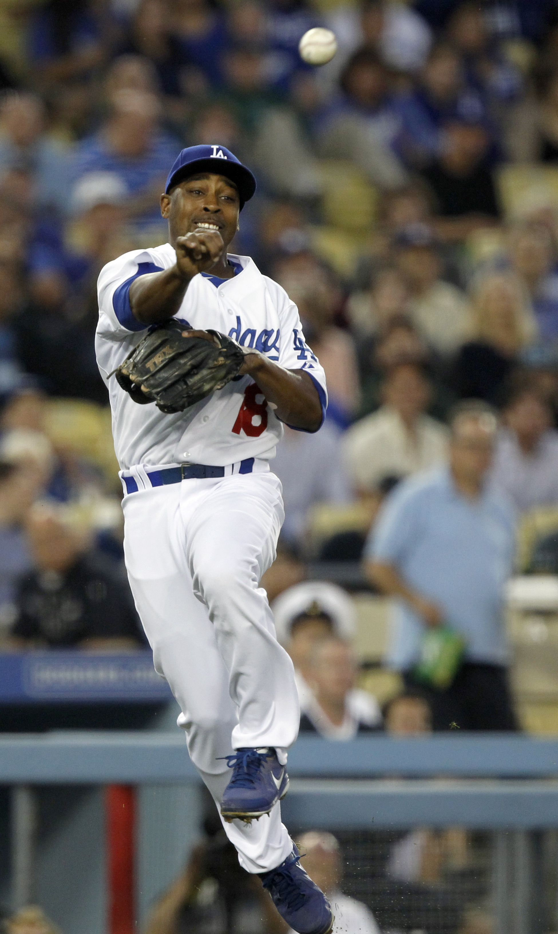 Los Angeles Dodgers third baseman Chone Figgins (18) throws out Arizona Diamondbacks Gerardo Parra in the third inning of a baseball game on Friday, June 13, 2014, in Los Angeles. (AP Photo/Alex Gallardo)