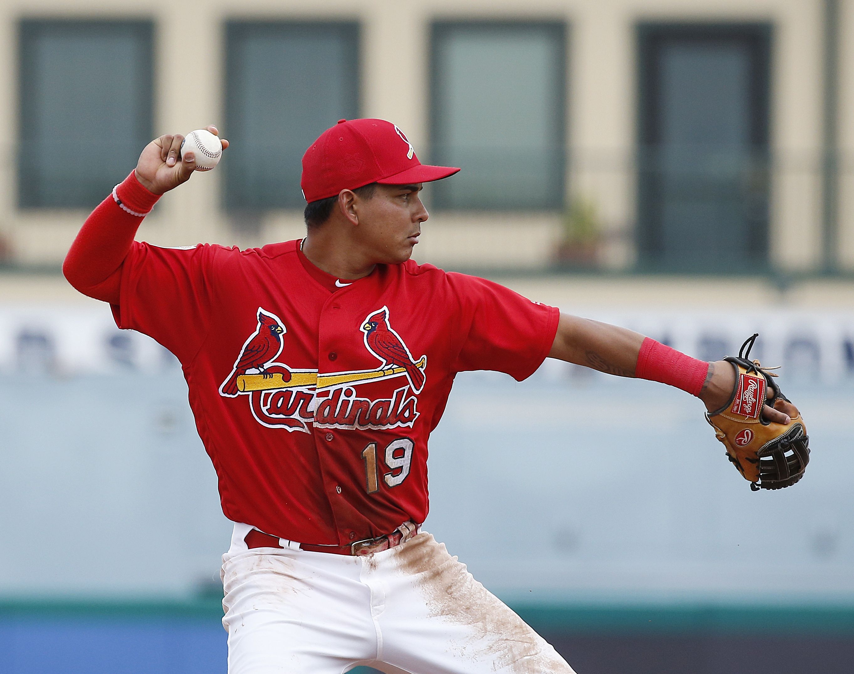 St. Louis Cardinals' short stop, Ruben Tejada, throws to first base during the fifth inning of an exhibition spring training baseball game against the Miami Marlins, Sunday, March 20, 2016, in Jupiter, Fla. (AP Photo/Brynn Anderson)