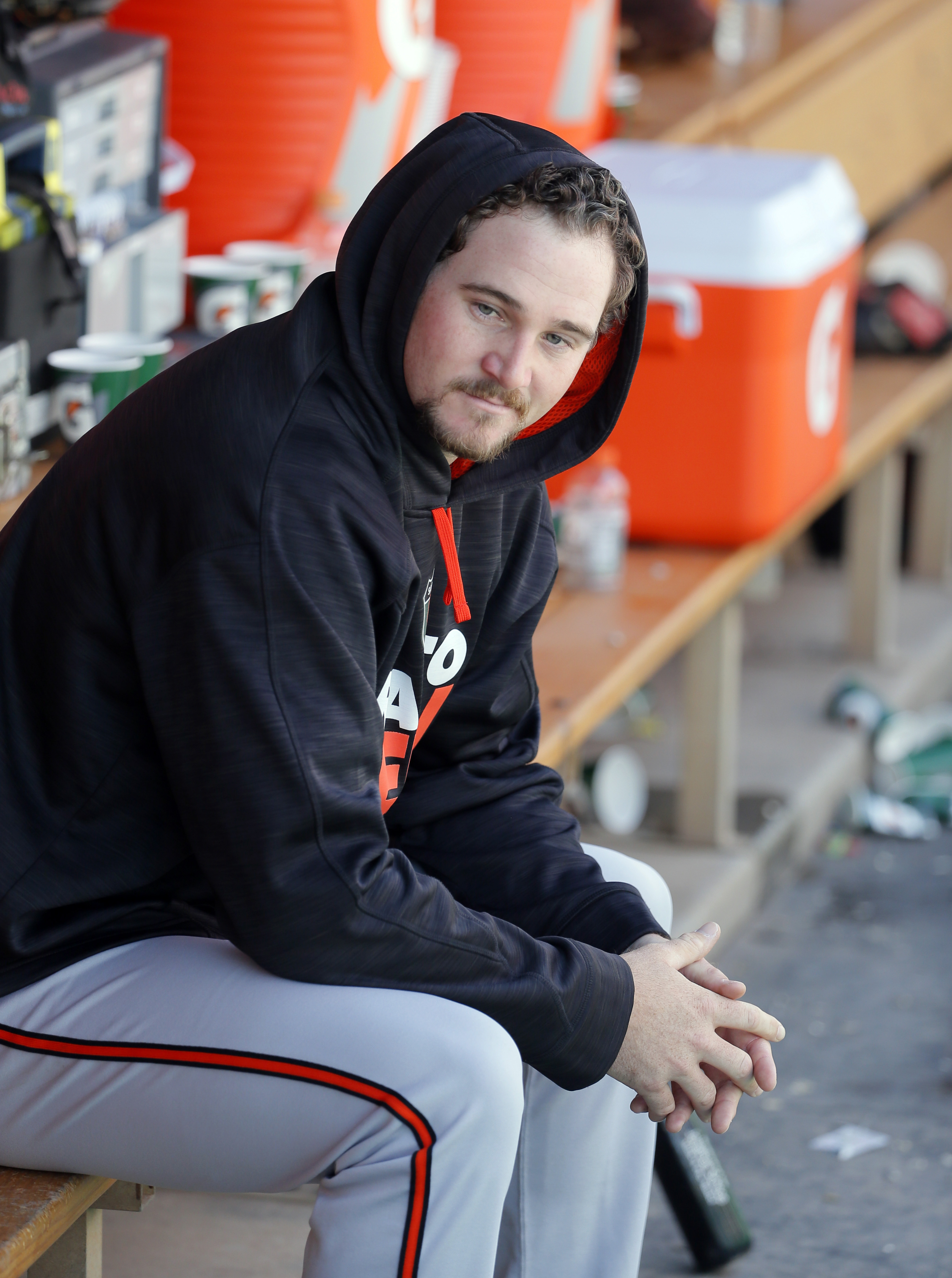 Baltimore Orioles starting pitcher Mike Wright sits in the dugout in the first inning of a spring training baseball game against the Minnesota Twins, Tuesday, March 22, 2016, in Fort Myers, Fla. (AP Photo/Tony Gutierrez)