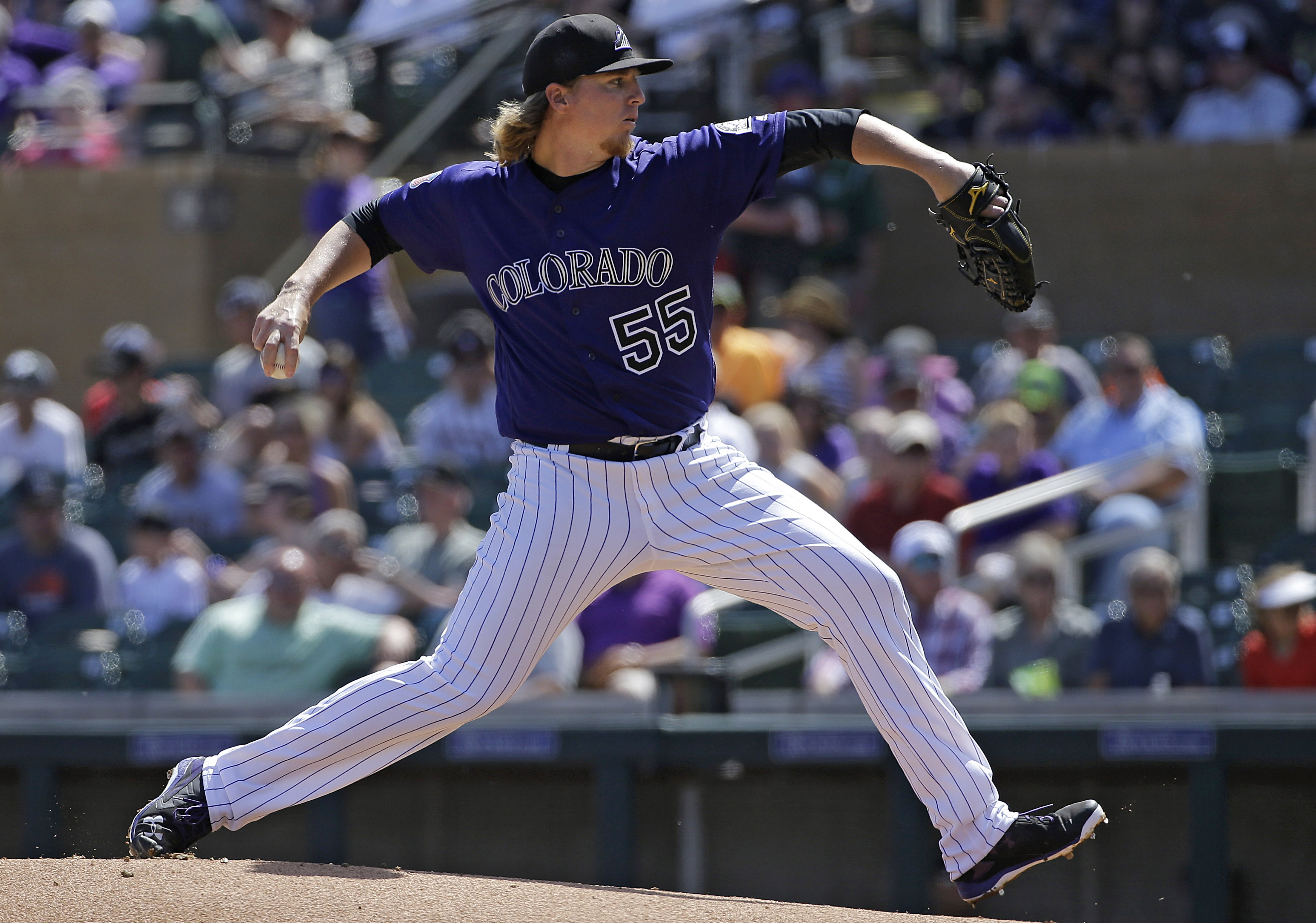 Colorado Rockies starting pitcher Jon Gray throws during the first inning of a spring training baseball game against the Milwaukee Brewers in Scottsdale, Ariz., Tuesday, March 22, 2016. (AP Photo/Jeff Chiu)
