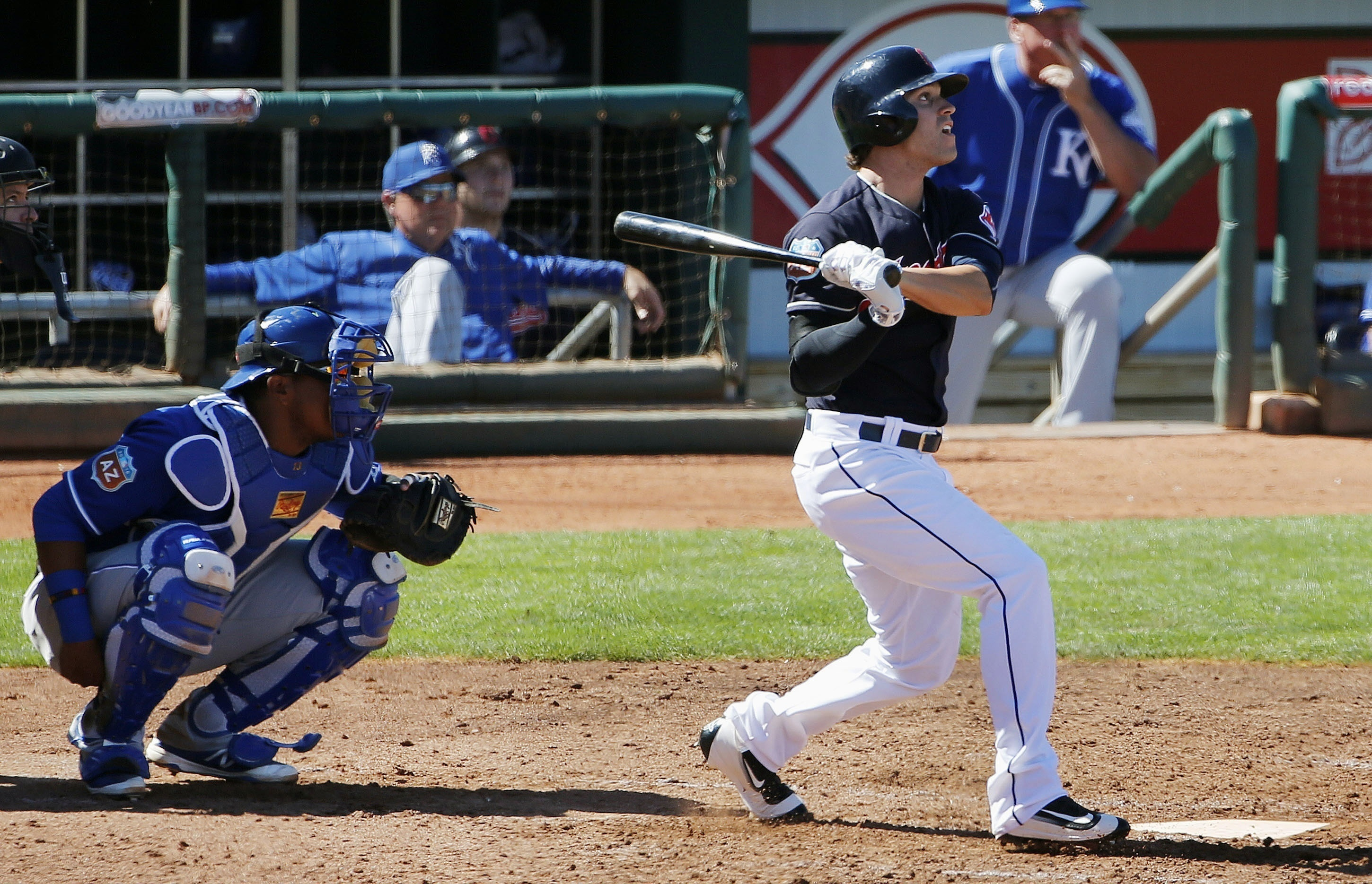 Cleveland Indians' Tyler Naquin, right, watches the flight of his home run as Kansas City Royals' Salvador Perez, left, looks on during the fourth inning of a spring training baseball game Wednesday, March 23, 2016, in Goodyear, Ariz. (AP Photo/Ross D. Fr