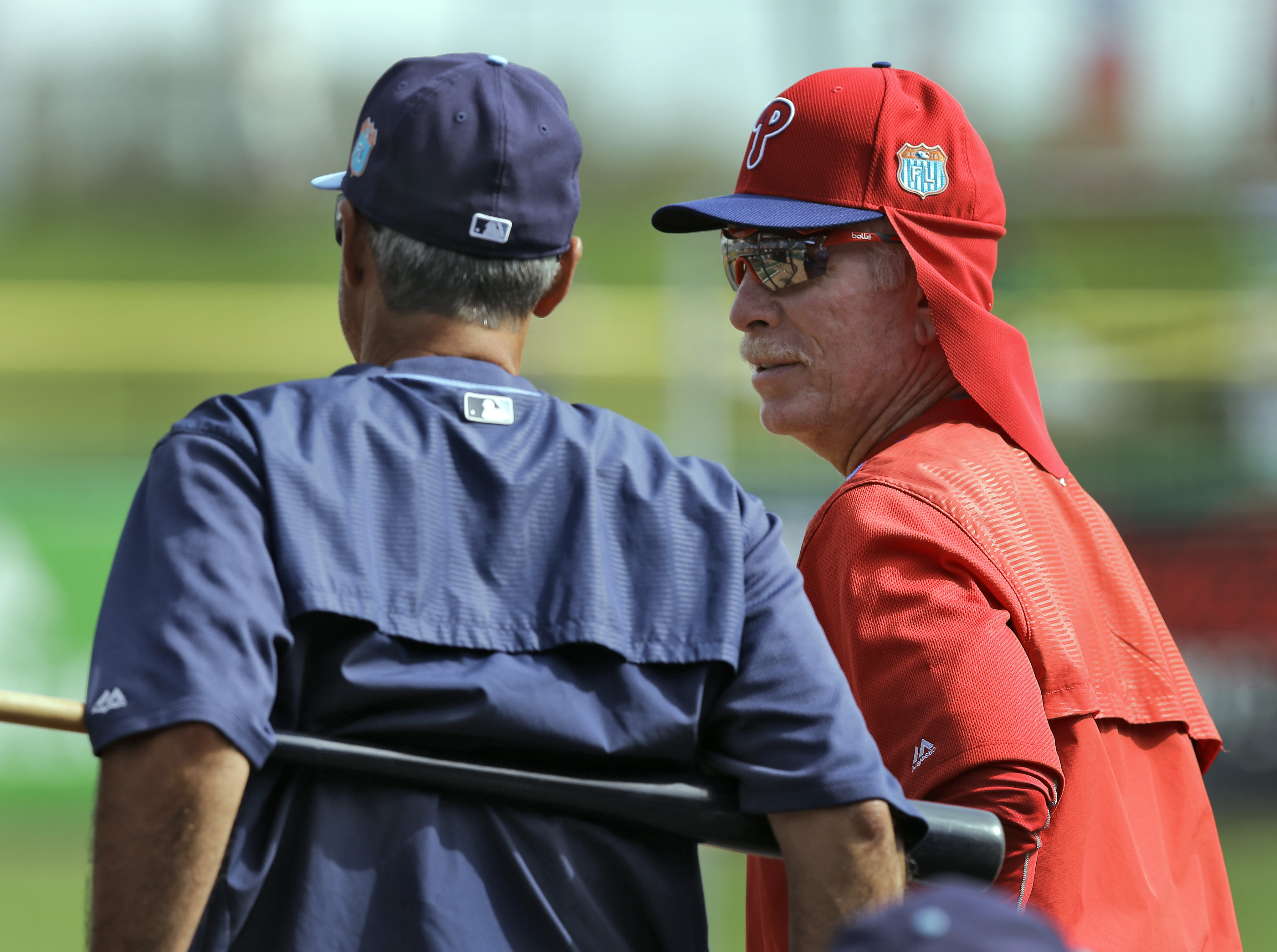 """FILE - In this March 17, 2016, file photo, Philadelphia Phillies instructor Mike Schmidt, right, talks to Tampa Bay Rays bench coach Tom Foley before a spring training baseball game in Clearwater, Fla. """"The players used to settle issues themselves. Cross"""