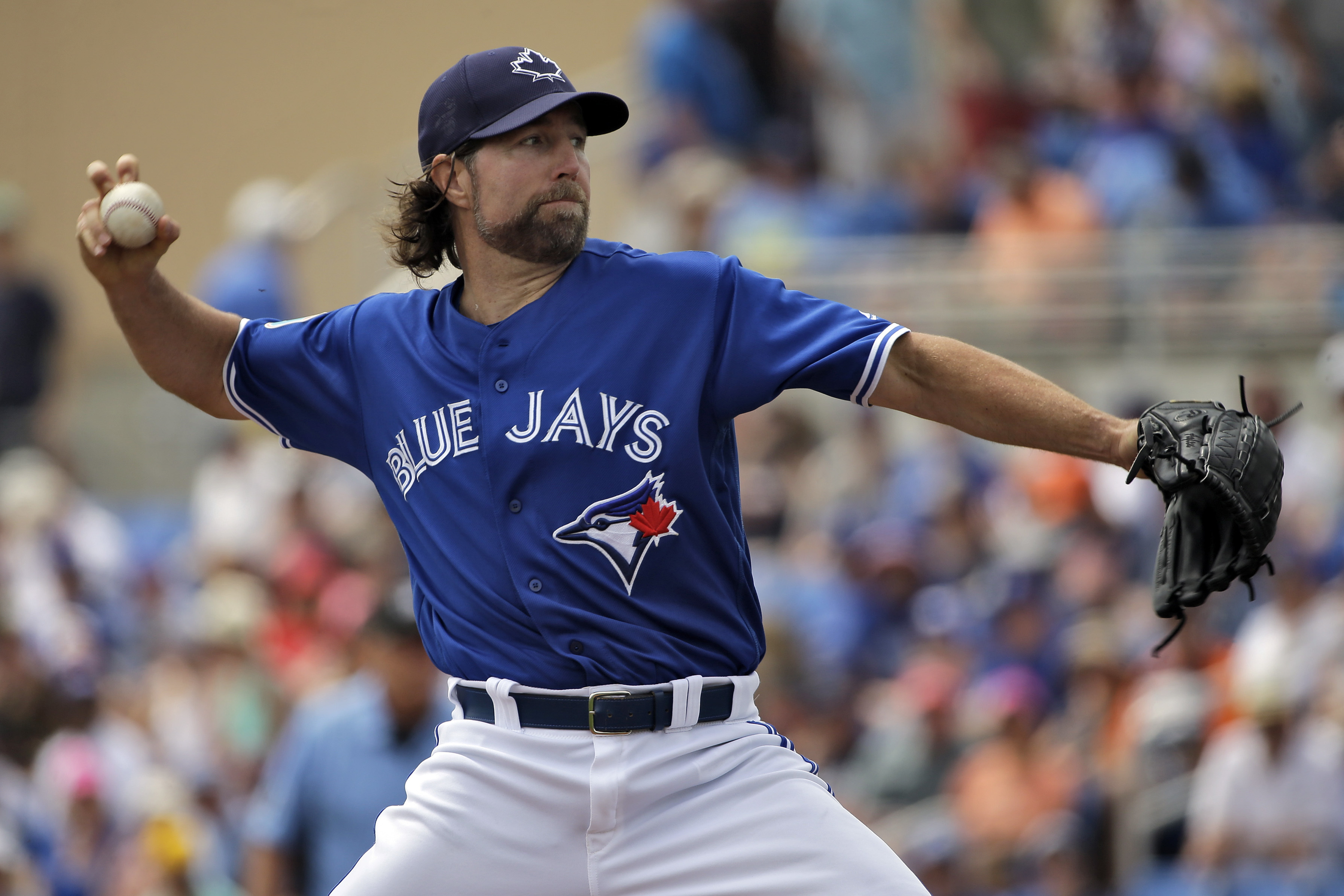Toronto Blue Jays starting pitcher R.A. Dickey delivers to the Detroit Tigers during the first inning of a spring training baseball game Thursday, March 24, 2016, in Dunedin, Fla. (AP Photo/Chris O'Meara)