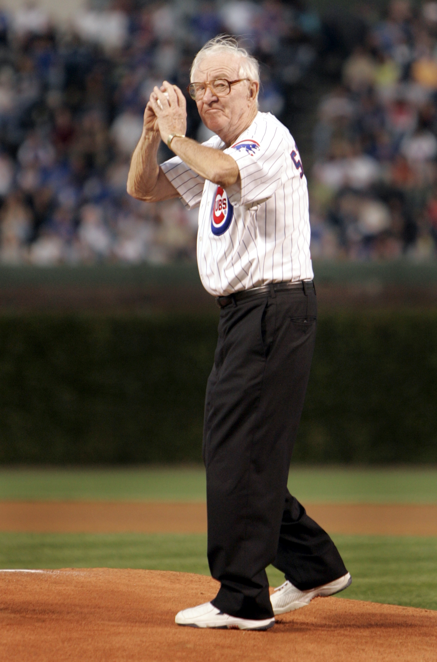 FILE - In this Sept. 14, 2005, file photo, U.S. Supreme Court Justice John Paul Stevens winds up to throw out the first pitch before the start of the Chicago Cubs game with the Cincinnati Reds at Wrigley Field in Chicago. As a boy, he watched his beloved