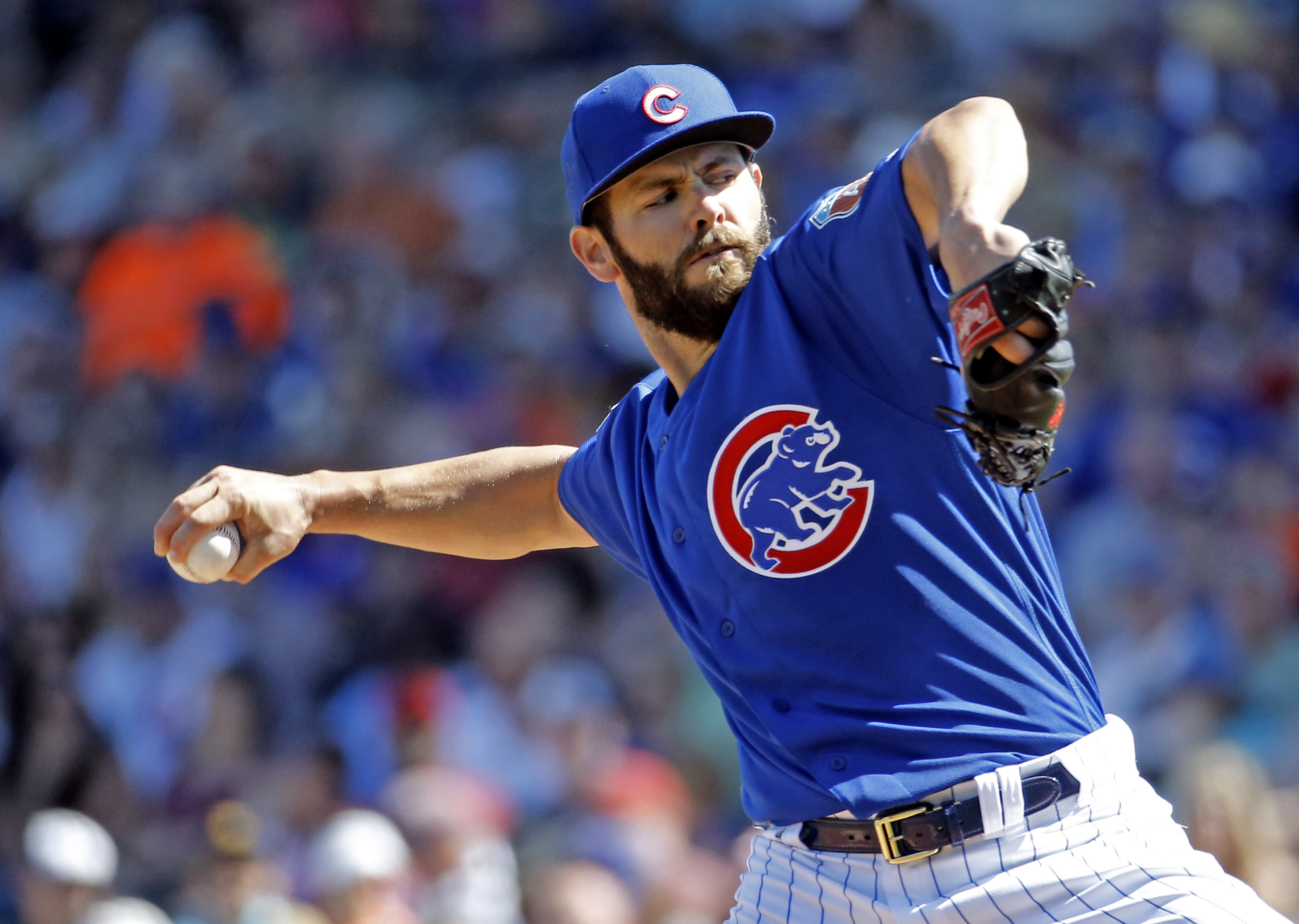 FILE - In this March 9, 2016, file photo, Chicago Cubs' Jake Arrieta throws during the first inning of a spring training baseball game against the Cleveland Indians, in Mesa, Ariz. The Cubs, a season after getting swept by the Mets in the NL Championship
