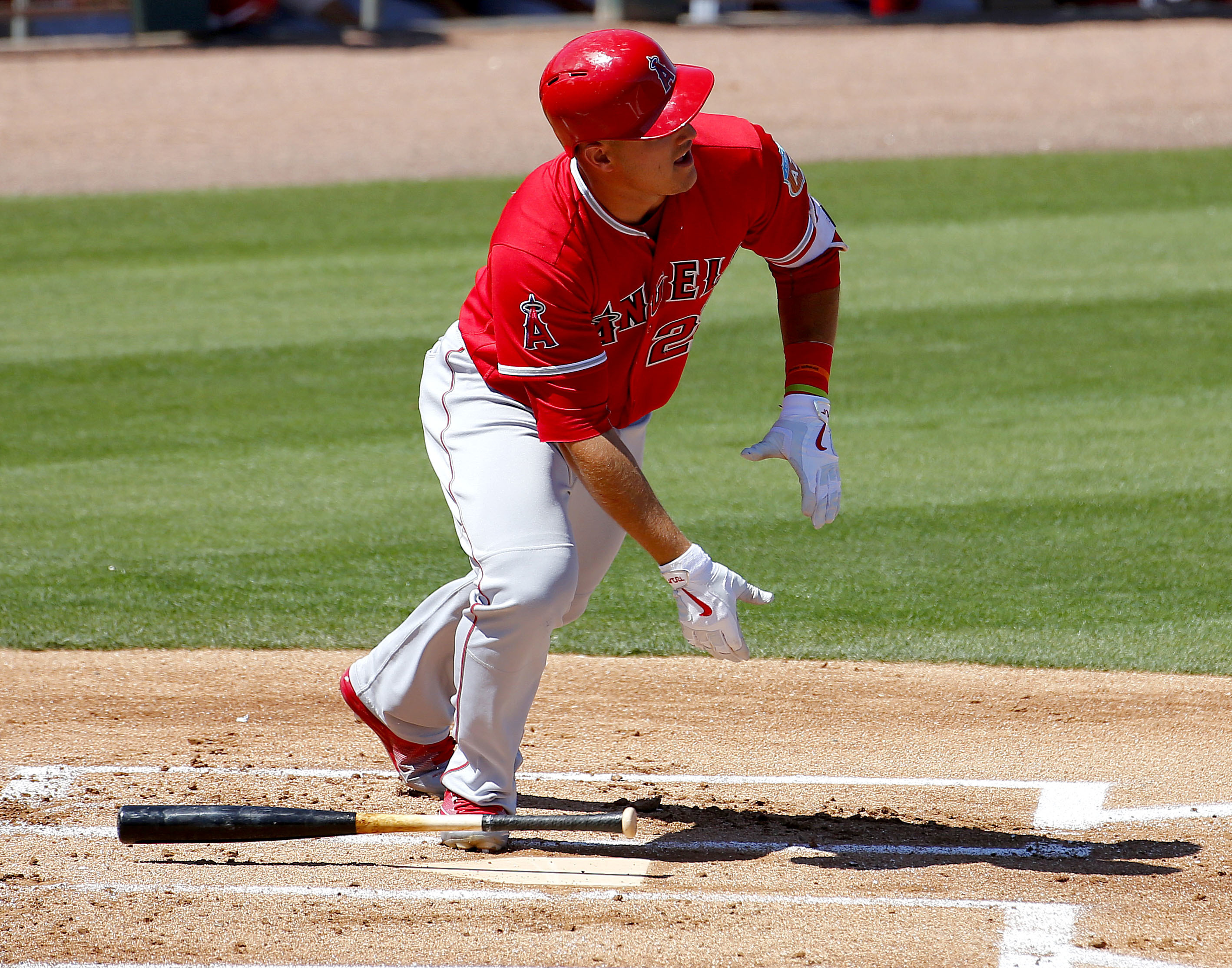 Los Angeles Angels Mike Trout breaks out of the batter's box after hitting a solo home run against the Oakland Athletics during the first inning of a spring training baseball game, Friday, March 25, 2016, in Mesa, Ariz. (AP Photo/Matt York)